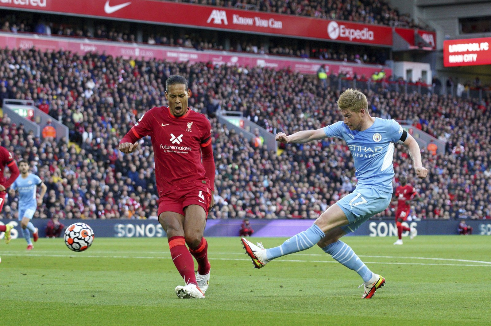 Manchester City's Kevin De Bruyne (R) shoots at goal during a Premier League match against Liverpool, at Anfield stadium, Liverpool, England, Oct. 3, 2021. (AP Photo)