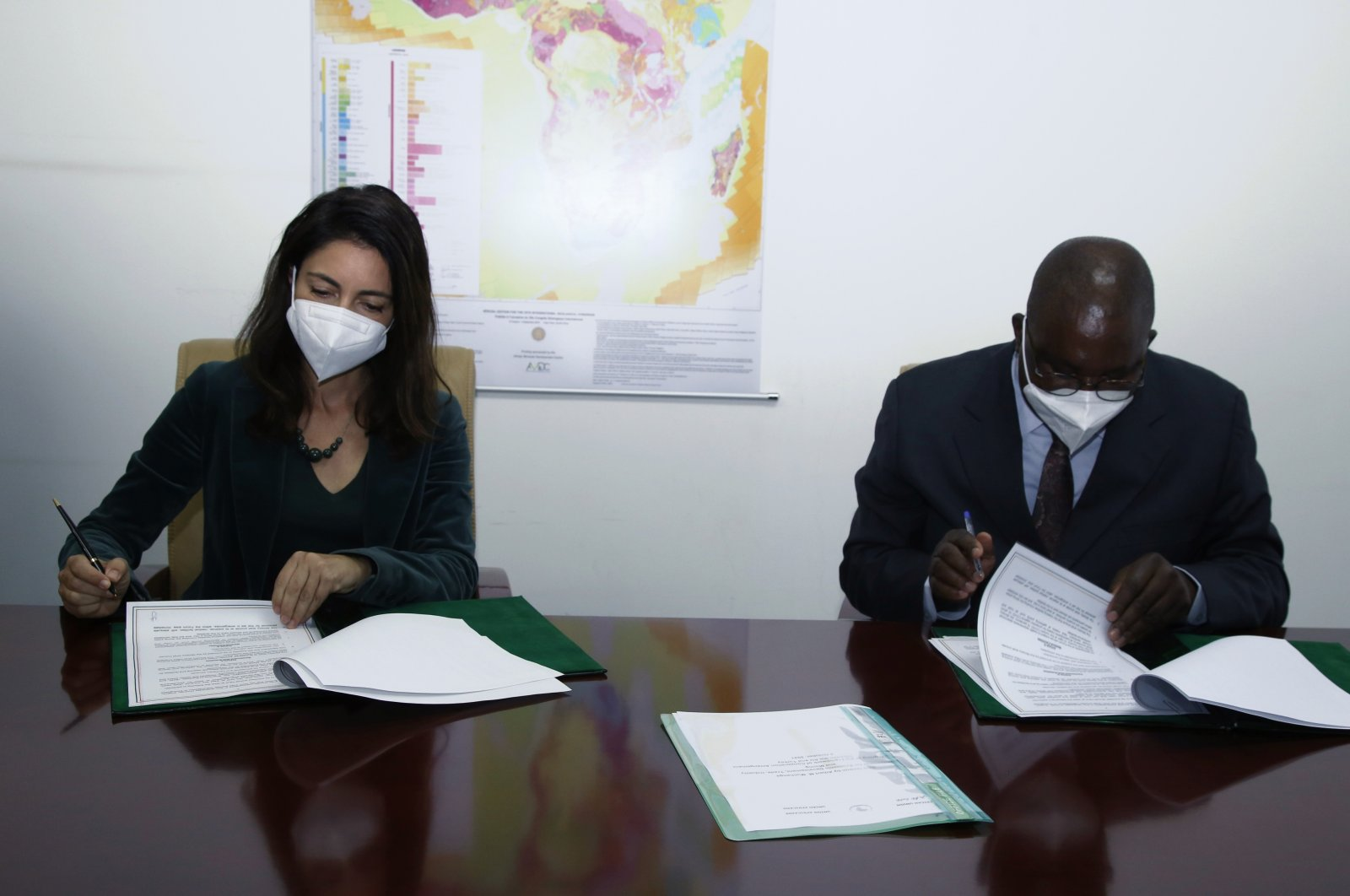 Ankara's Ambassador to Ethiopia and the African Union Yaprak Alp (L) and the African Union's Commissioner for Economic Development Trade, Industry and Mining Albert Muchanga sign agreements in Addis Ababa, Ethiopia, Oct. 5, 2021 (AA Photo)