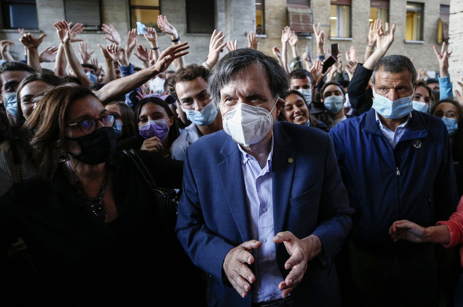 Italian physicist Giorgio Parisi is cheered by students as he arrives at the Sapienza University, in Rome, Italy, Oct. 5, 2021. (AP Photo)