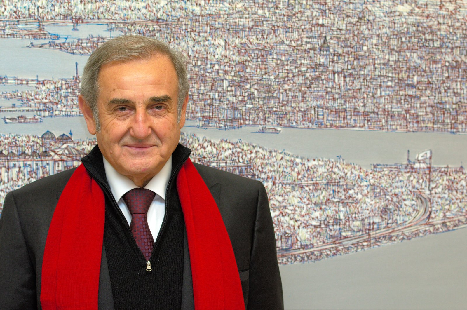 Devrim Erbil poses in front of one of his works.