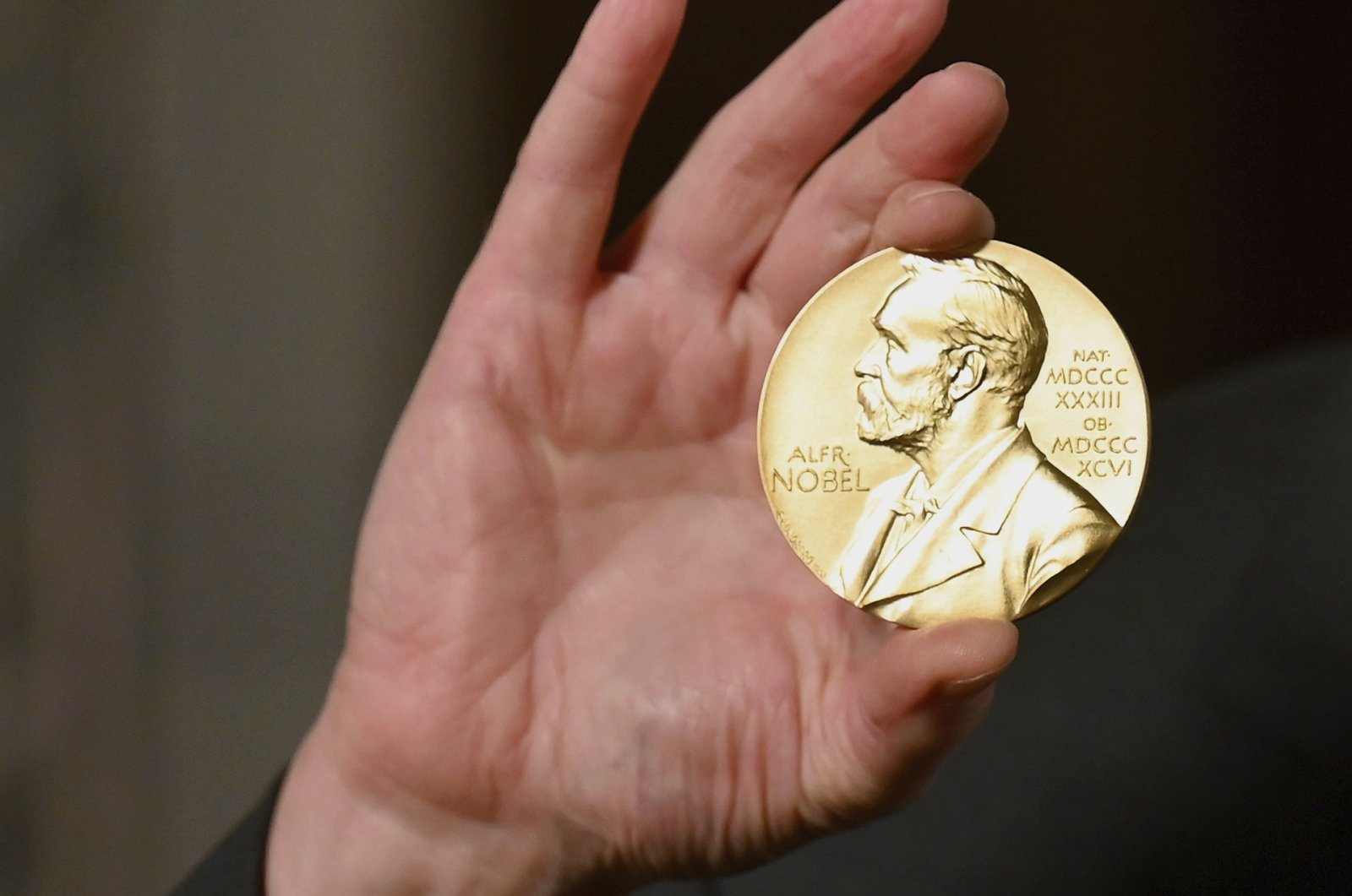 A Nobel medal is held up during a ceremony in New York, U.S., Dec. 8, 2020. (AP File Photo)