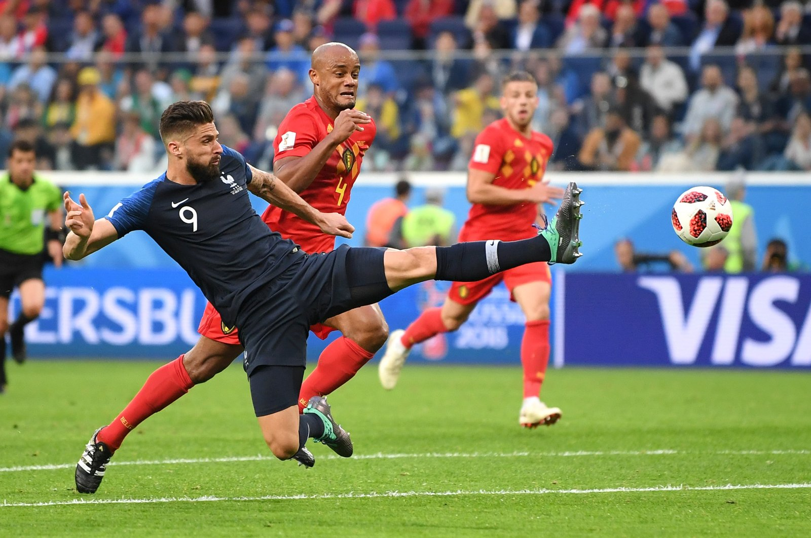 France's Olivier Giroud (front) in action during a Fifa World Cup in St. Petersburg, Russia, July 10, 2018. (Getty Images)