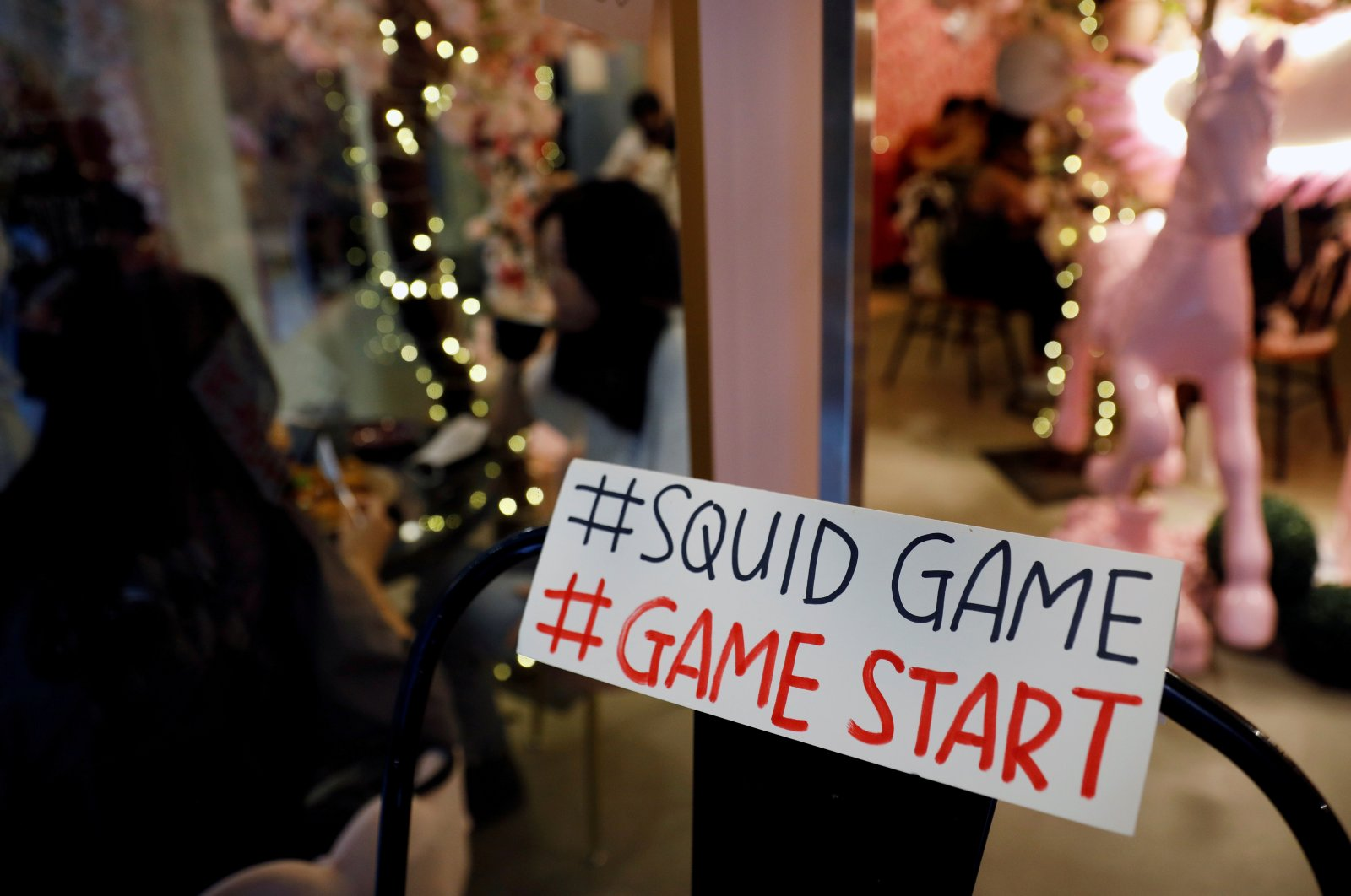 """A sign referring to the """"honeycomb challenge"""" featured in Netflix's new hit series """"Squid Game"""" is seen at Brown Butter Cafe in Singapore, Oct. 1, 2021. (Reuters Photo)"""