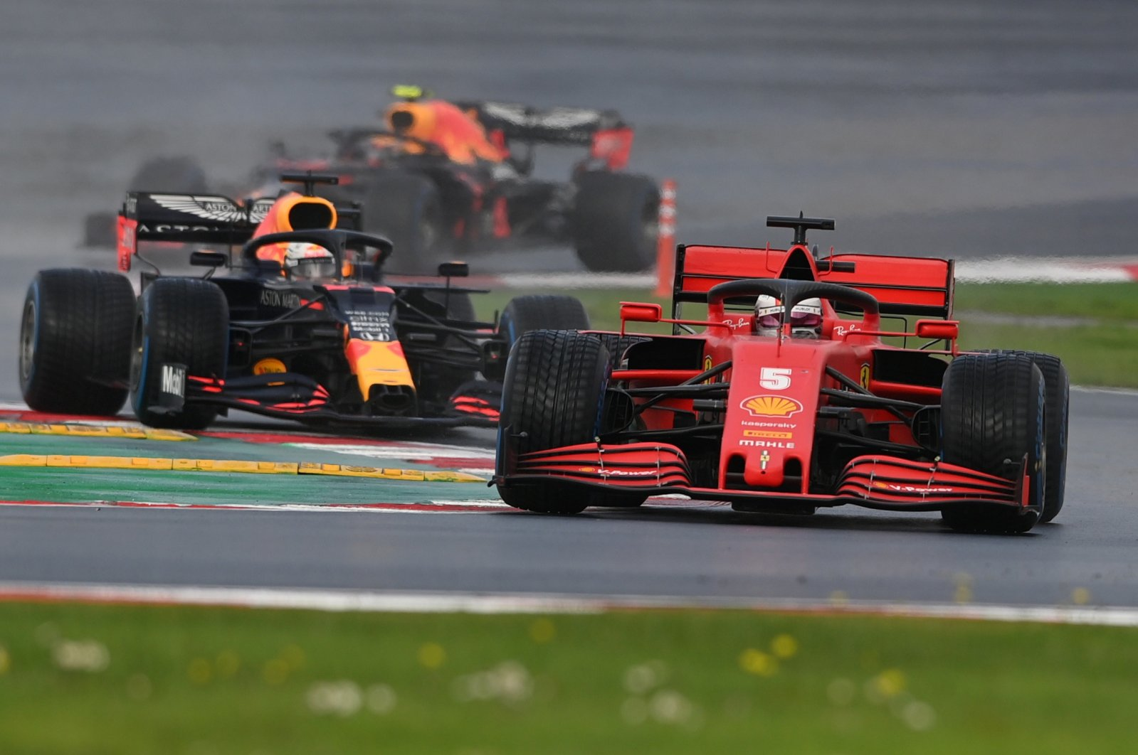 Ferrari's Sebastian Vettel and Red Bull's Max Verstappen in action during the Formula One Turkish Grand Prix at Istanbul Park, Istanbul, Turkey, Nov. 15, 2020. (Reuters Photo)