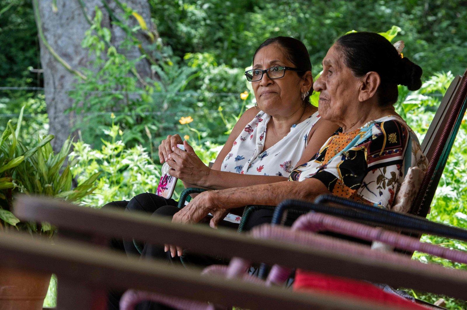 "Natividad ""Talia"" Matarrita Fonseca (R), 93, sits next to her sister Sara Fonseca at their home in Nicoya, Costa Rica, Aug. 28, 2021. (AFP Photo)"