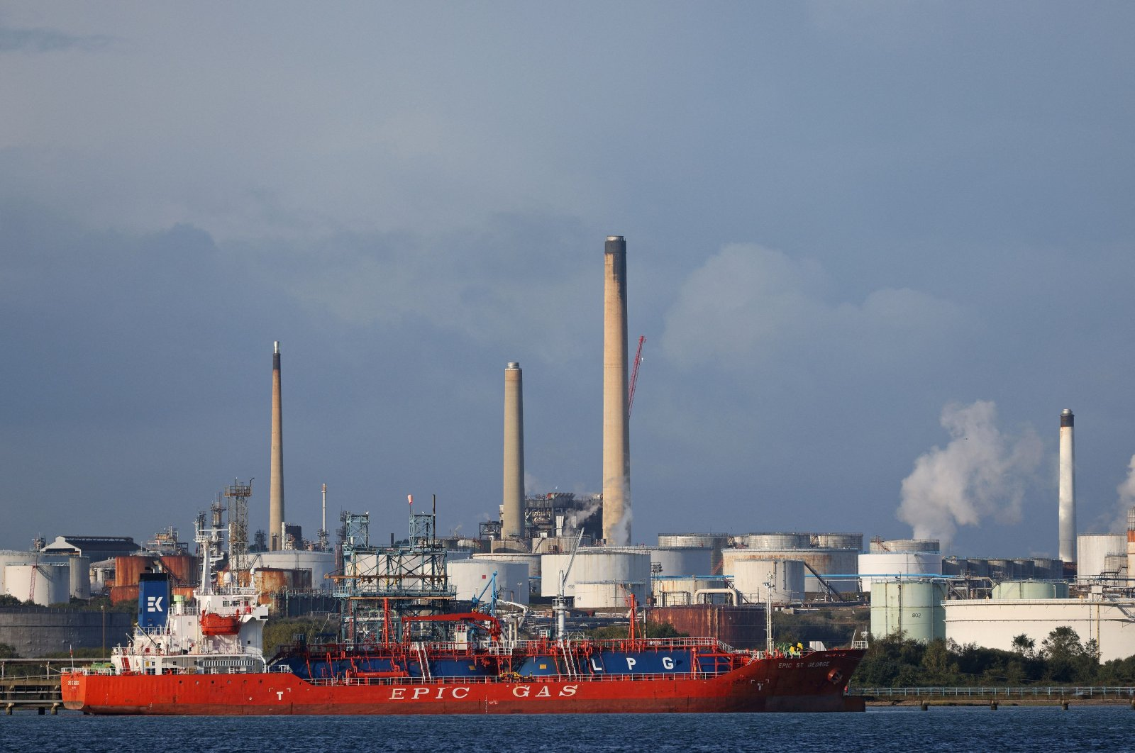 The MV Epic St George LNG (liquid natural gas tanker) passes the Esso Oil refinery in Fawley, near Southampton, southern England, Oct. 4, 2021. (AFP Photo)