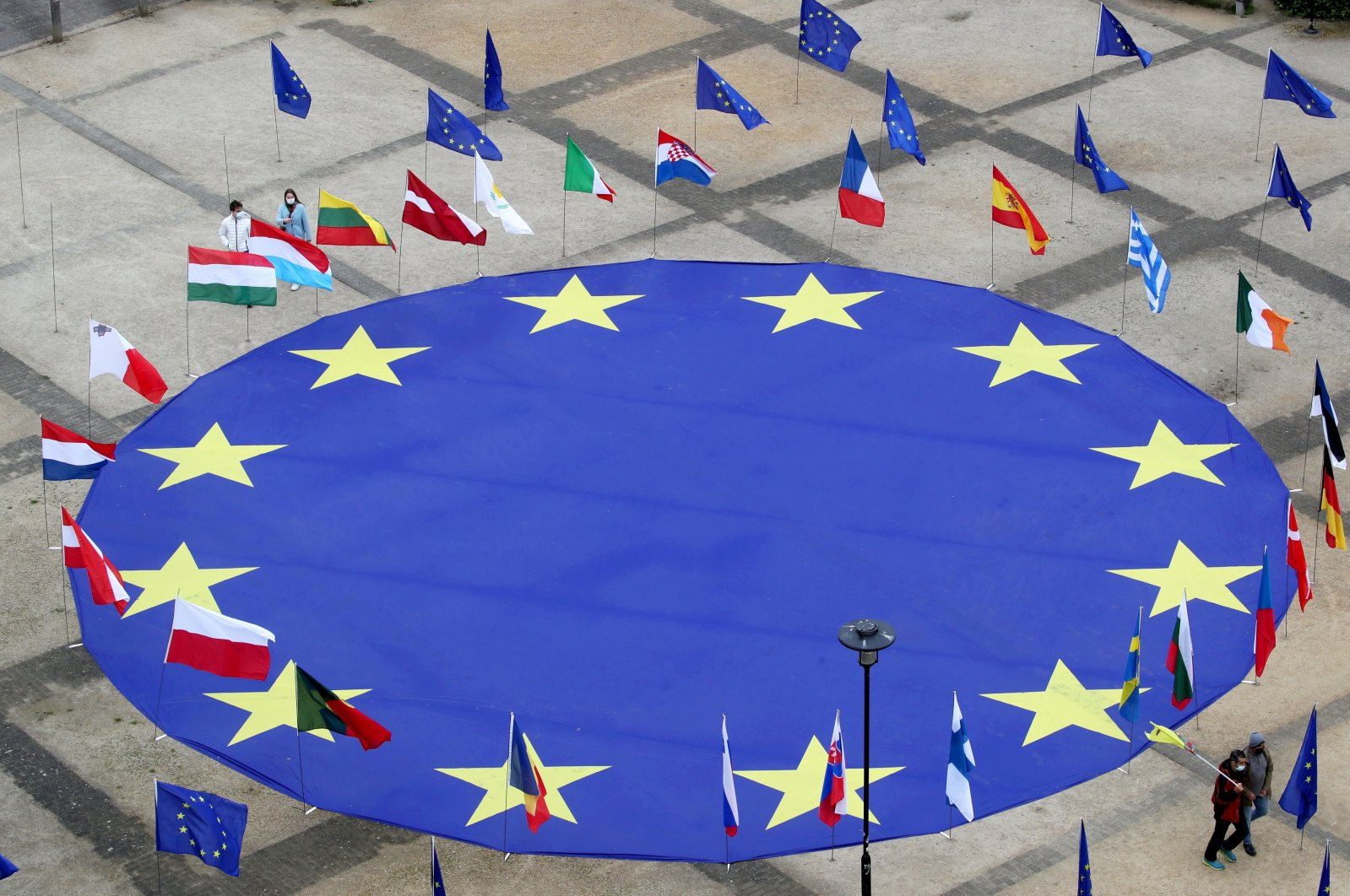 A large European Union flag lies at the center of Schuman Square outside European Commission headquarters in Brussels, Belgium, May 8, 2021. (Reuters Photo)