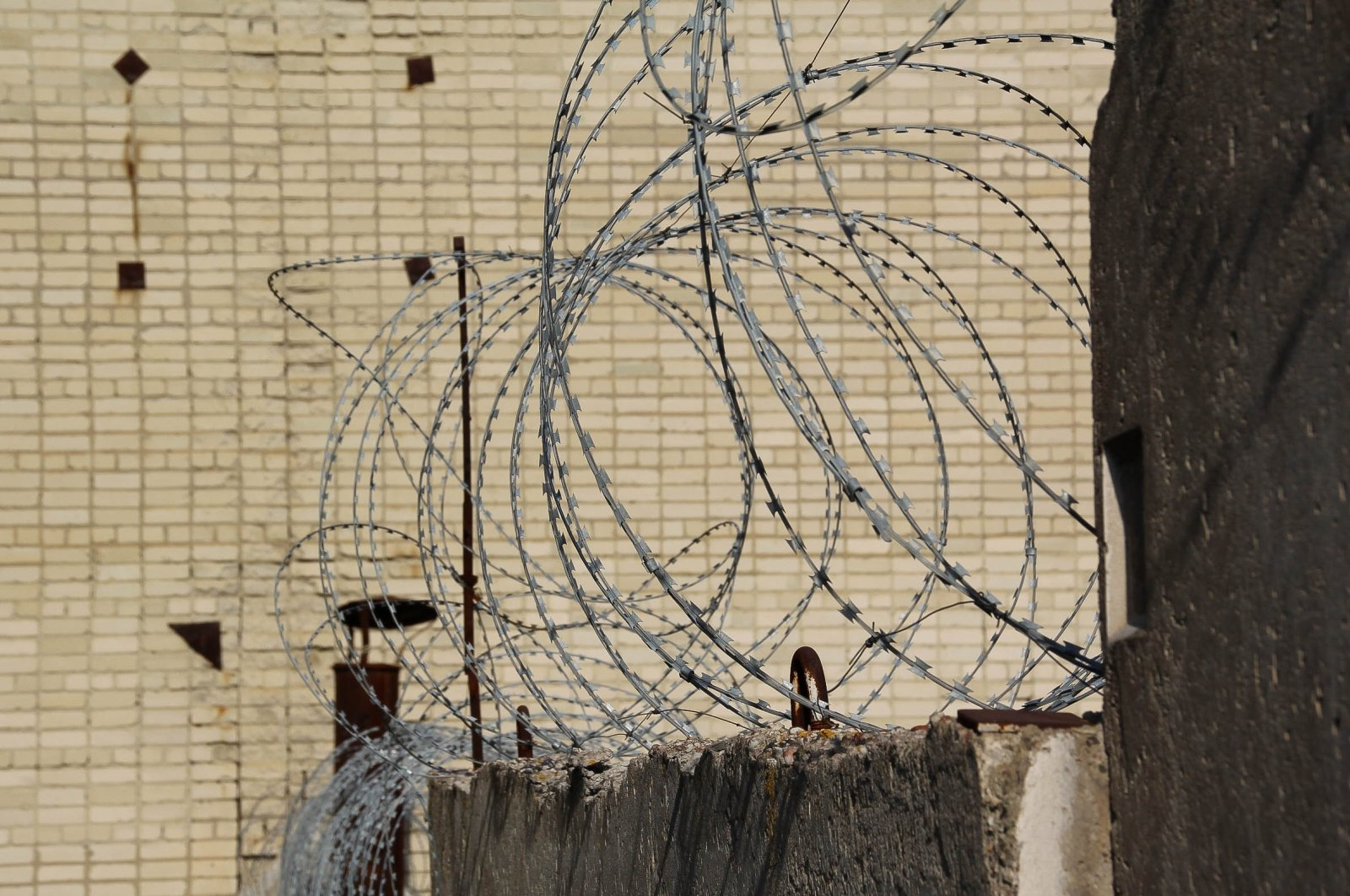 A close view of barbed wire fencing at the Regional Tuberculosis Hospital No 1 under the Russian Federal Penitentiary Service, its staff charged with abusing convicts, Russia, Oct. 6, 2021. (Reuters Photo)