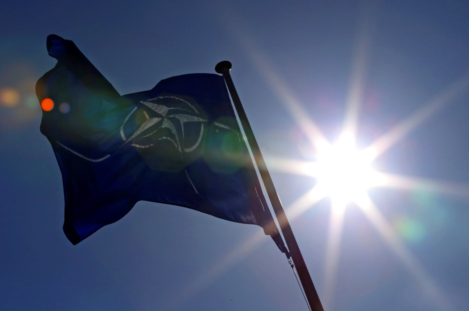 A NATO flag flies at the Alliance headquarters in Brussels during a NATO ambassadors meeting on the situation in Ukraine and the Crimea region, March 2, 2014. (Reuters Photo)