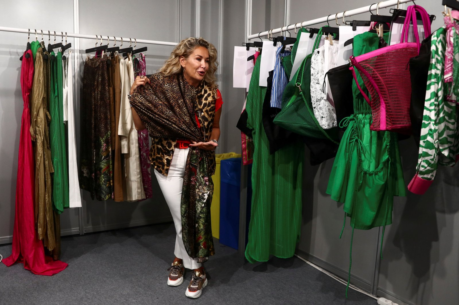 Spanish designer Maite Casademunt displays one of her outfits backstage before her show during Mercedes Benz Fashion Week in Madrid, Spain, Sept. 16, 2021. (Reuters Photo)
