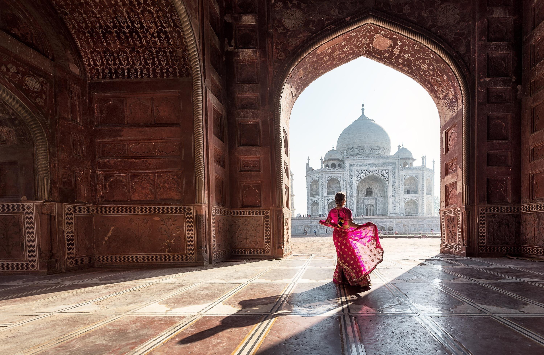 Woman in red saree/sari in the Taj Mahal, Agra, Uttar Pradesh, India. (Shutterstock Photo)