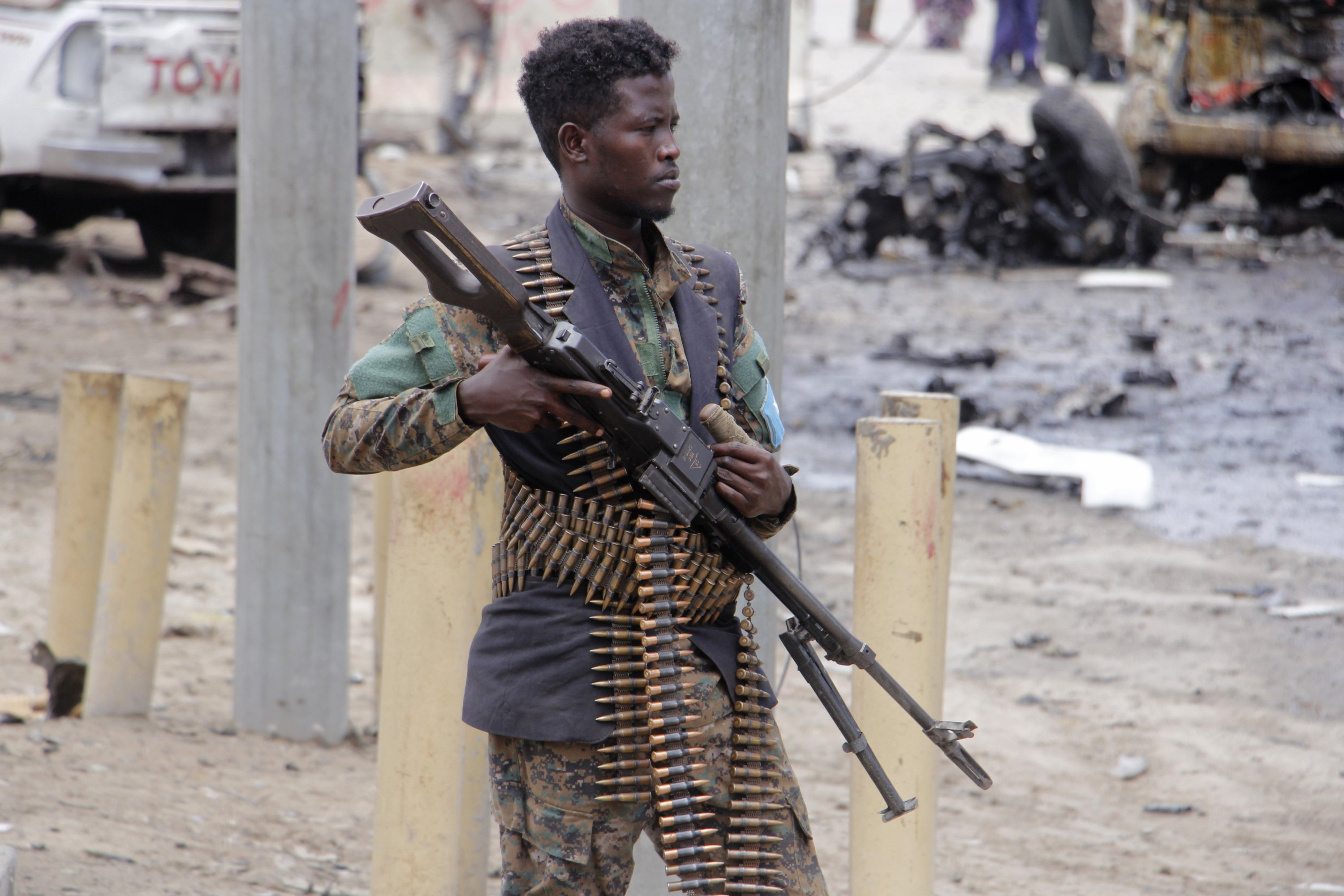 A Somali soldier secures the area after a car bomb attack at a Presidential Palace checkpoint in Mogadishu, Somalia, Saturday Sept. 25, 2021. (AP Photo)