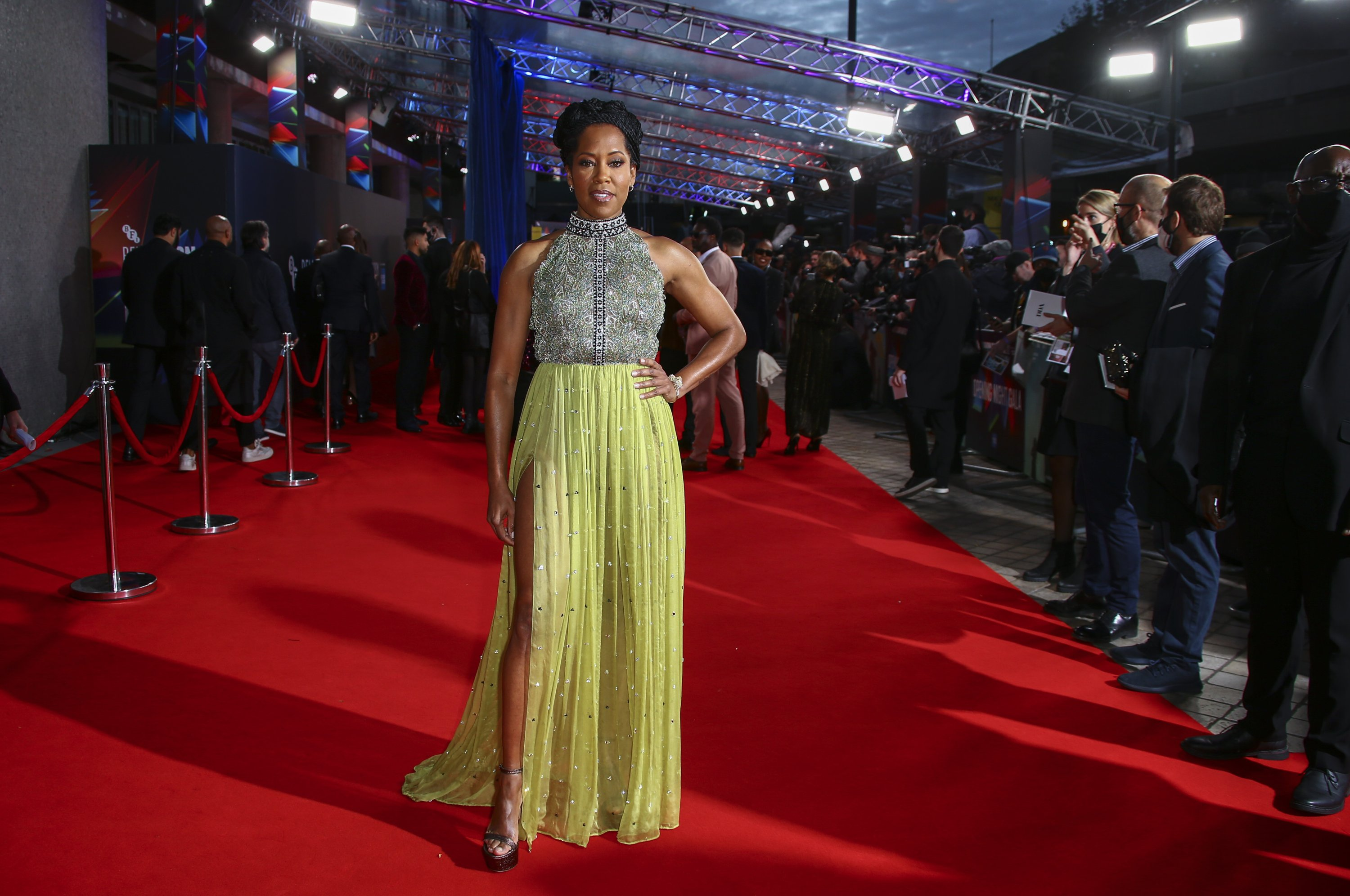 Regina King poses for photographers upon arrival at the opening of the London film festival and the World premiere of the film 'The Harder They Fall' in London, Oct. 6, 2021. (AP)