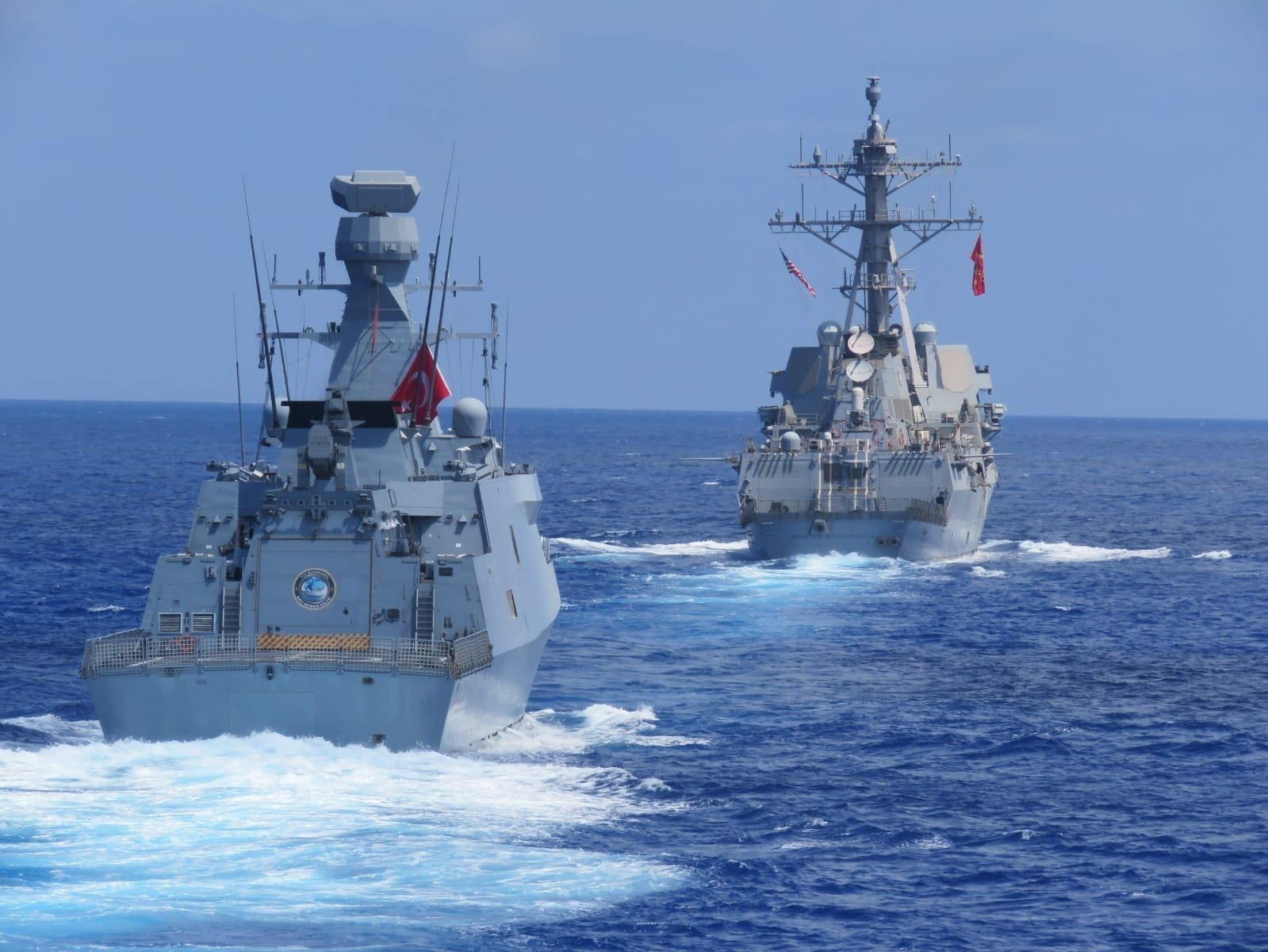 Turkish frigates TCG Barbaros and TCG Burgazada conducts maritime training with American destroyer USS Winston S. Churchill in the Eastern Mediterranean, Aug. 26, 2020. (DHA)
