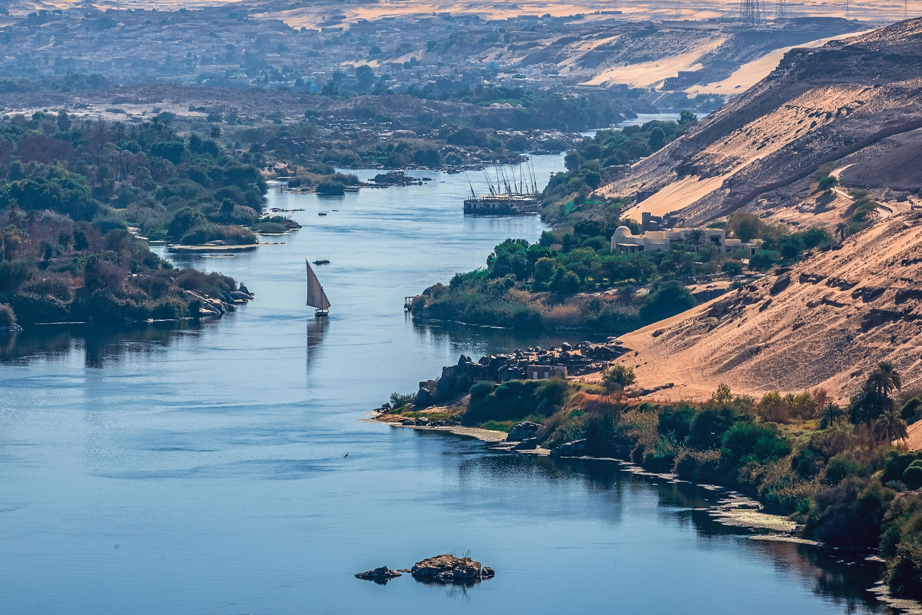 Sunset over the Nile River in the city of Aswan, Egypt, with sandy and deserted shores. (Shutterstock Photo)