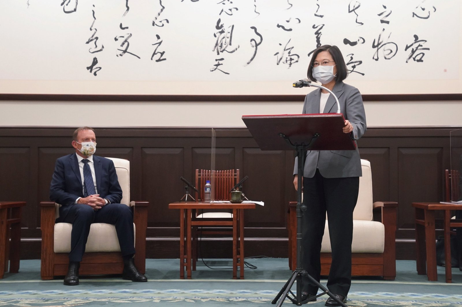 Taiwan's President Tsai Ing-wen speaks next to the former Australian Prime Minister Tony Abbott during their meeting in Taipei, Taiwan, Oct. 7, 2021. (Reuters Photo)