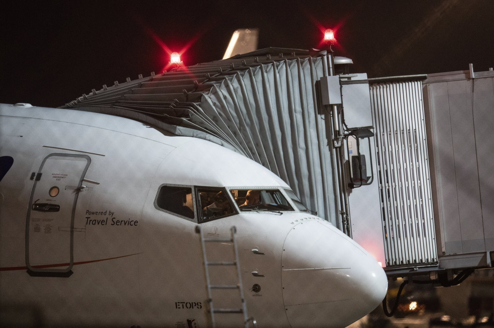 A charter plane stands in position at Frankfurt Airport in Frankfurt, Germany, Oct. 7, 2021. (DPA via AP)