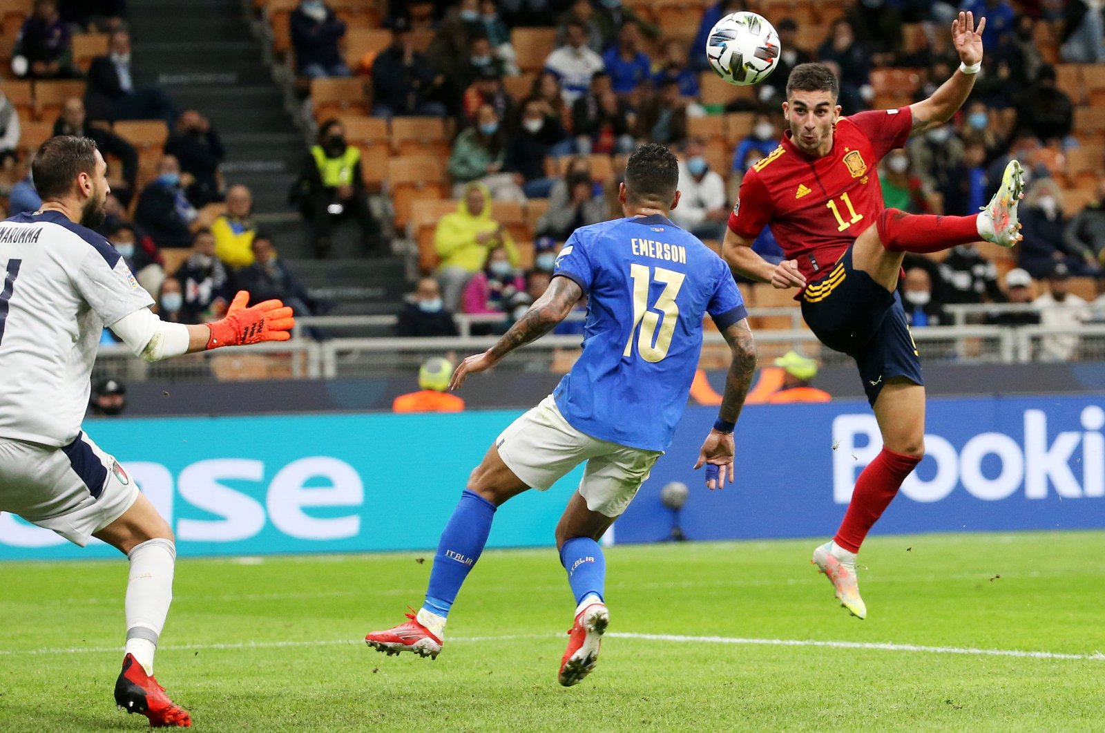 Spain's Ferran Torres (R) as Spain scores its second goal against Italy in the UEFA Nations League semifinal, Milan, Italy, Oct. 6, 2021. (EPA Photo)