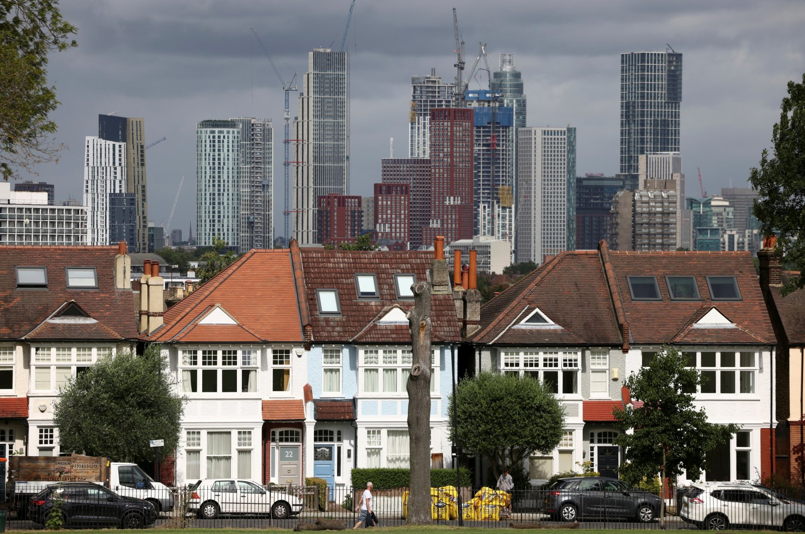High-rise apartments under construction can be seen in the distance behind a row of residential housing in south London, Britain, Aug. 6, 2021. (Reuters Photo)