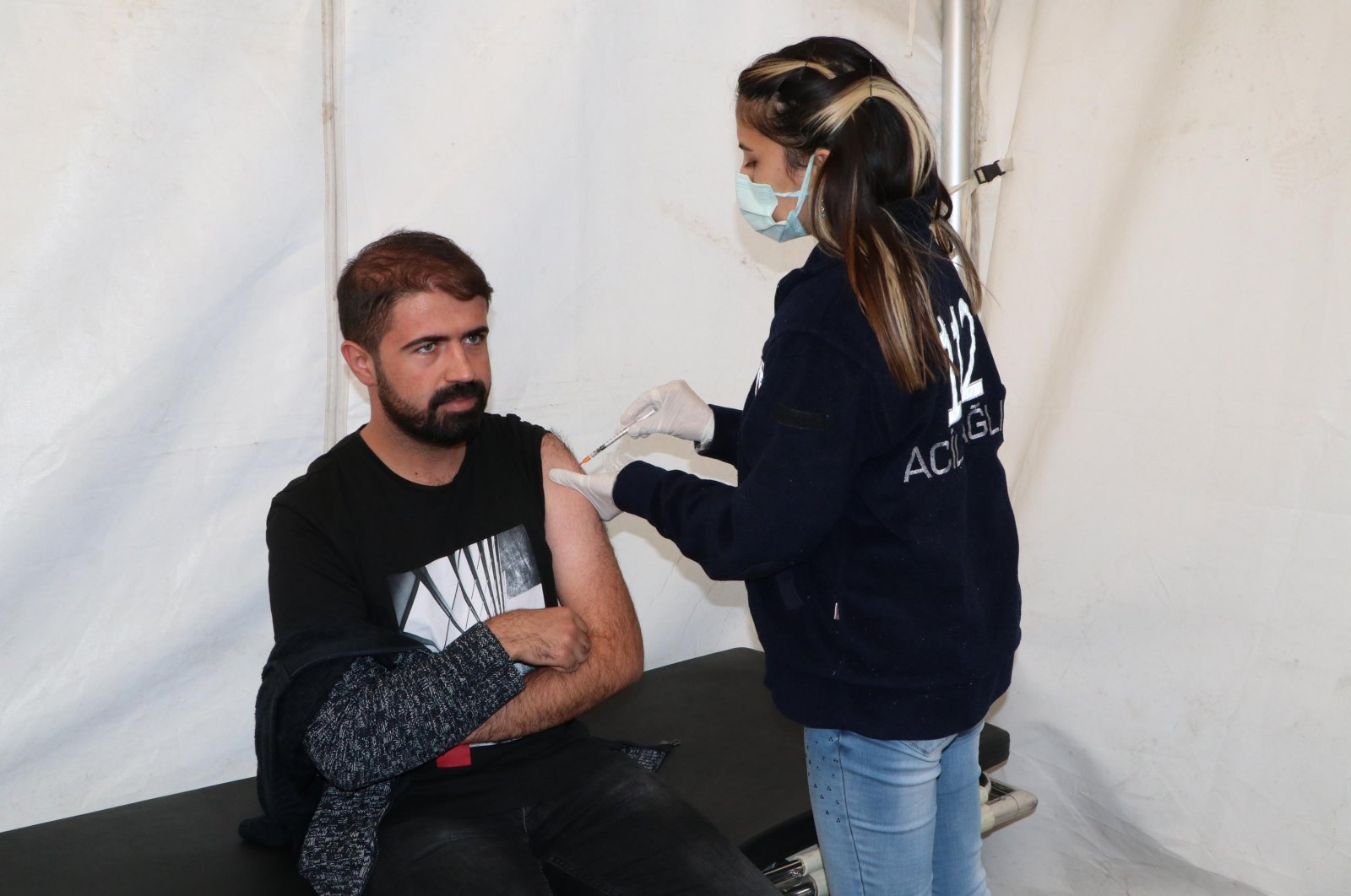 A man gets vaccinated against COVID-19 at a vaccination tent, in Van, eastern Turkey, Oct. 6, 2021. (DHA PHOTO)