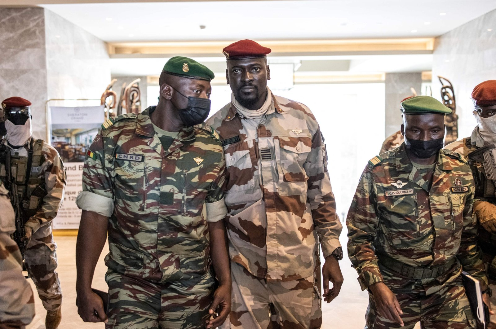 President of the National Committee for Rally and Development (CNRD) Col. Mamady Doumbouya (C) leaves a meeting with high-level representatives of the Economic Community of West African States (ECOWAS) in Conakry, Guinea, Sept. 17, 2021,  (AFP Photo)