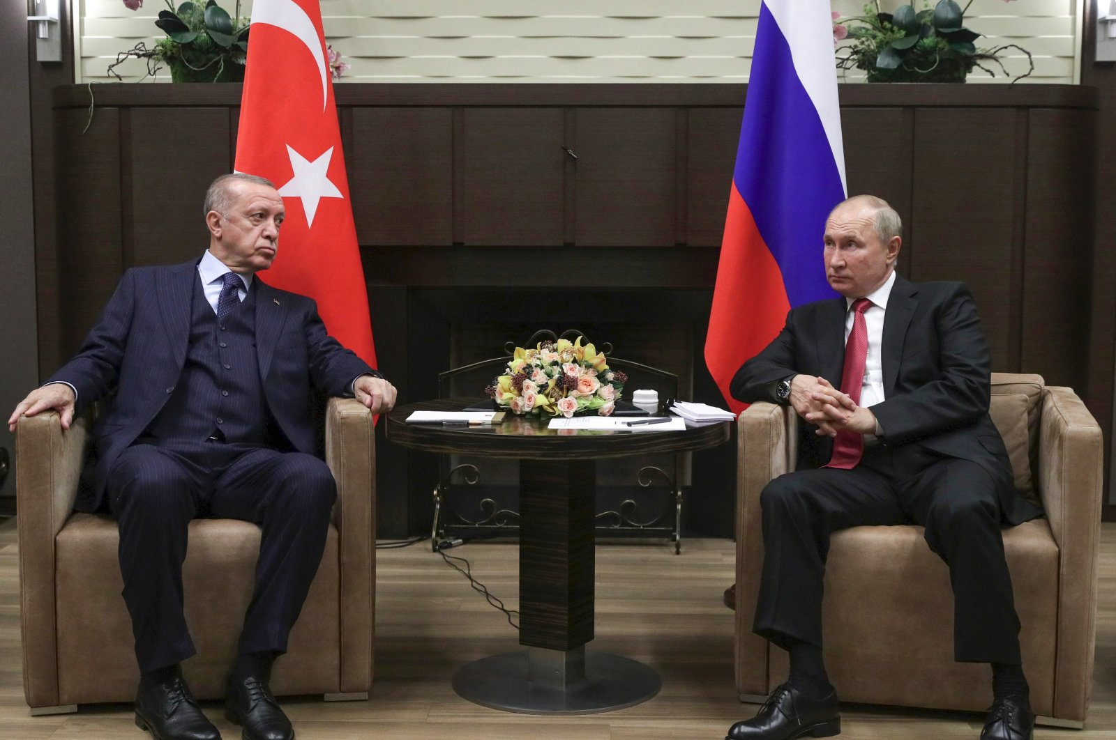 President Recep Tayyip Erdoğan and Russian President Vladimir Putin talk to each other during their meeting in the Bocharov Ruchei residence in the Black Sea resort of Sochi, Russia, Sept. 29, 2021. (AP File Photo)