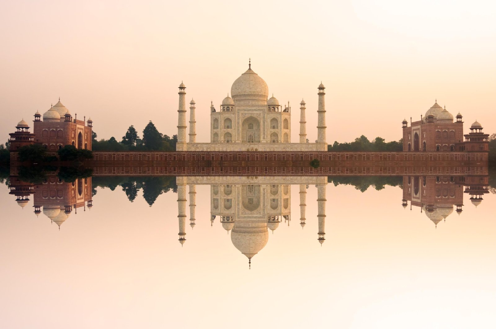 Panoramic view of Taj Mahal at sunset with reflection, Agra, India. (Shutterstock Photo)
