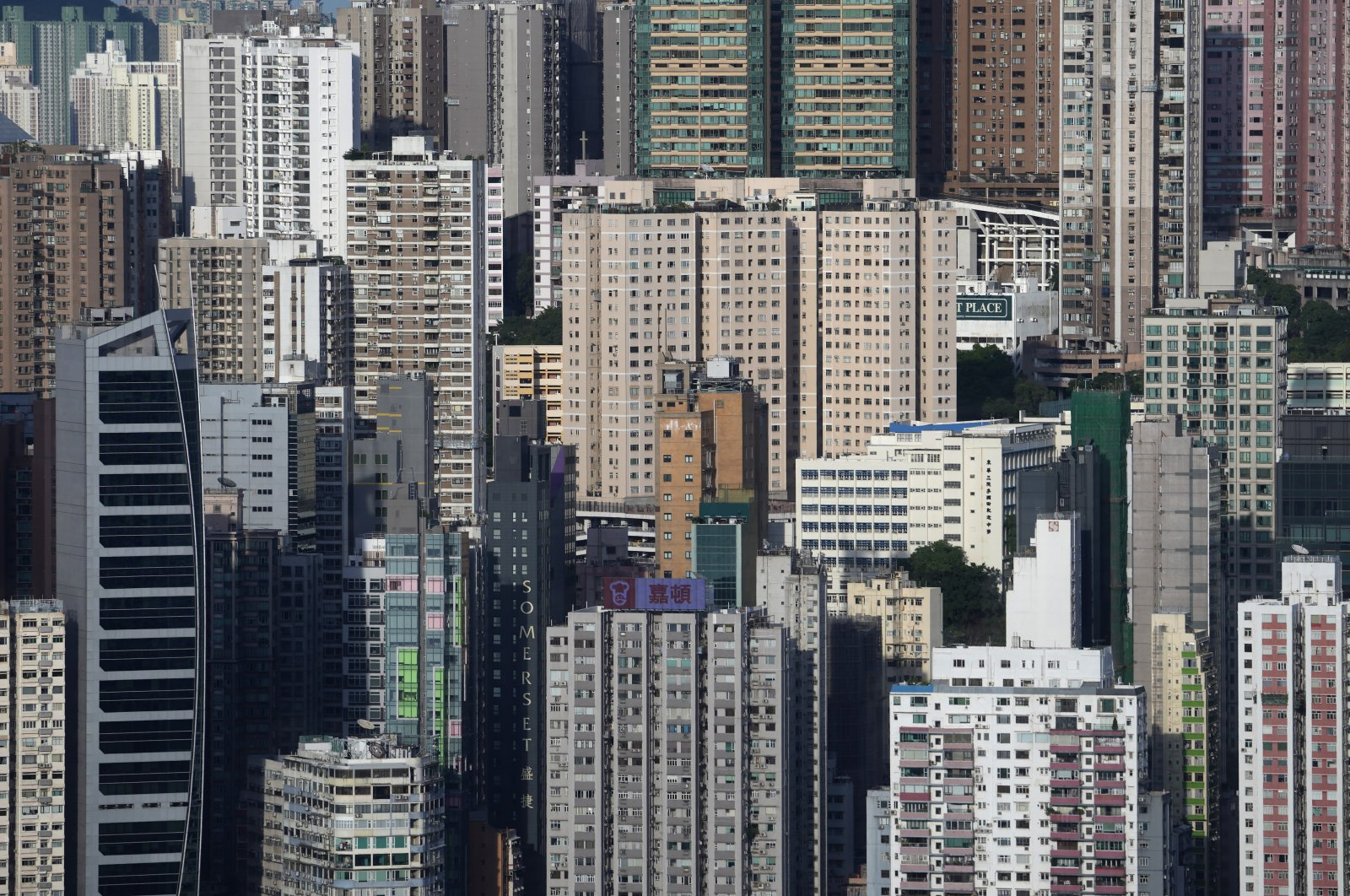 A general view of high-rise residential buildings and skyscrapers are seen in Hong Kong, Sept. 21, 2021. (AP Photo)