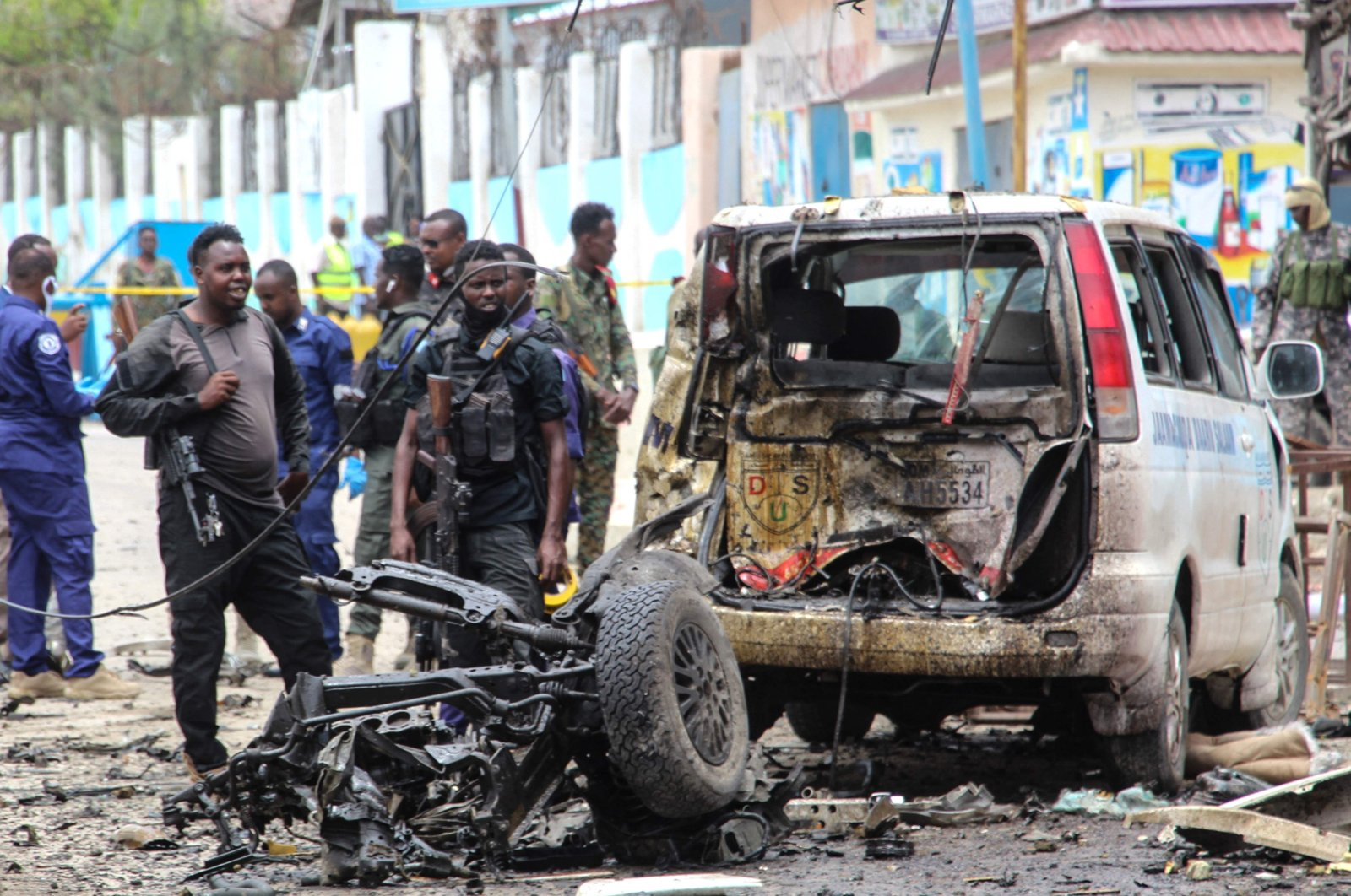 Security officers patrol on the site of a car-bomb attack in Mogadishu, on September 25, 2021. (AFP Photo)