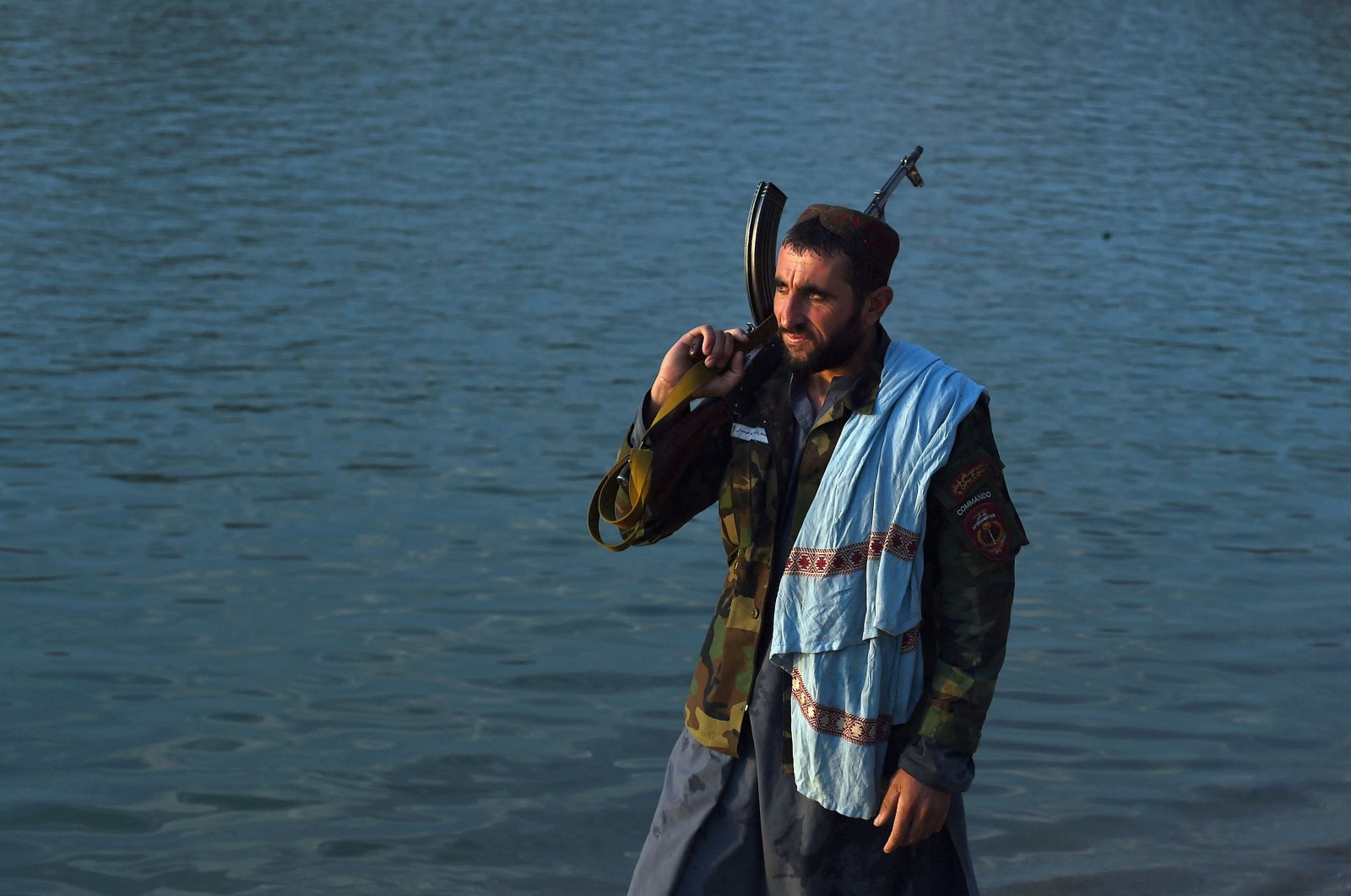 A Taliban fighter stands on the banks of Lake Qargha on the outskirts of Kabul, Afghanistan, Sept. 28, 2021. (AFP Photo)