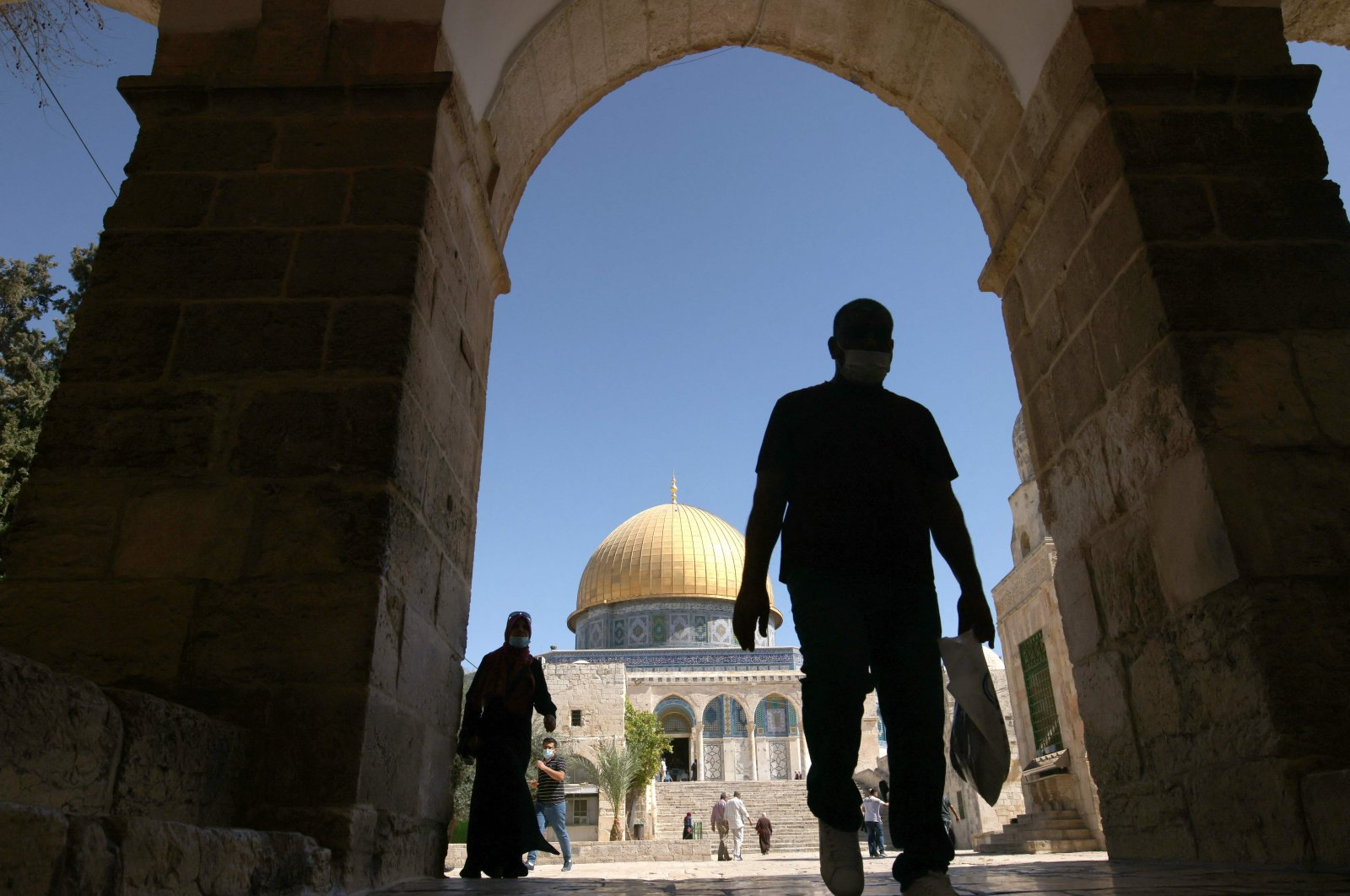 Palestinians are pictured in front of the Dome of the Rock shrine at the Al-Aqsa Mosque compound in the Old City, East Jerusalem, occupied Palestine, Oct. 7, 2021. (AFP Photo)