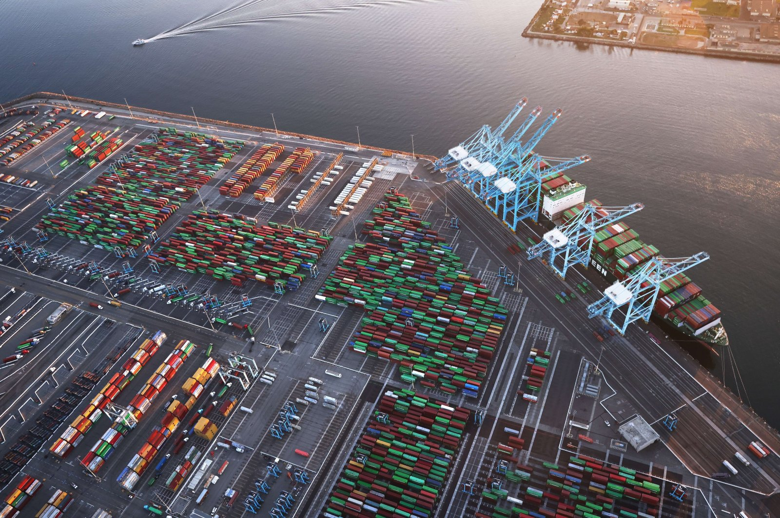 In an aerial view, shipping containers and a container ship are seen at the Port of Los Angeles near Los Angeles, California, U.S. Sept. 20, 2021. (AFP Photo)