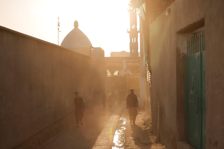 People walk in an alleyway in Kabul, Afghanistan, Oct. 7, 2021. (Reuters Photo)