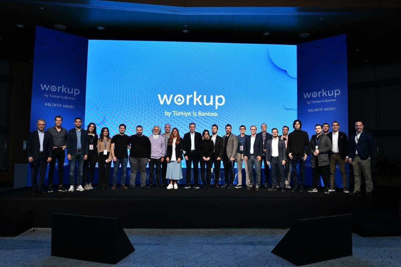Members of startup graduates of the Workup Entrepreneurship Program and other officials are seen on the stage during Demo Day, in Istanbul, Turkey, Oct. 2, 2021. (DHA Photo)