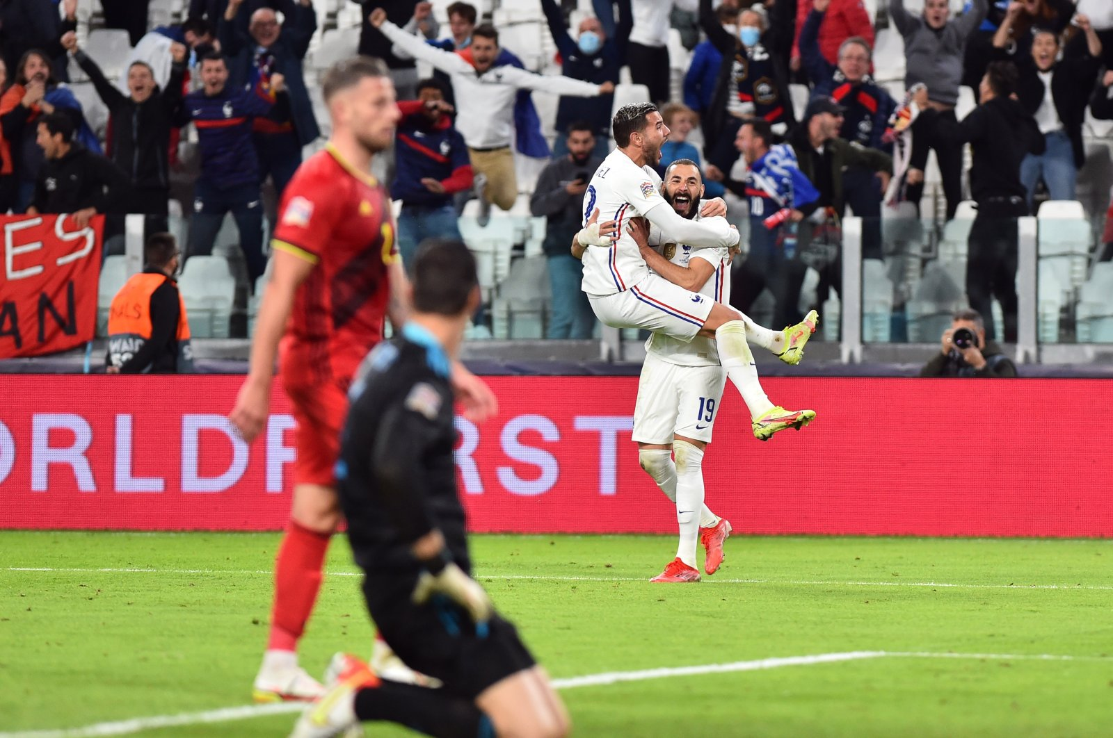 France's Karim Benzema (R) and Theo Hernandez celebrate their team's third goal during a Nations League match against Belgium at the Allianz Stadium, in Turin, Italy, Oct. 7, 2021. (Reuters Photo)