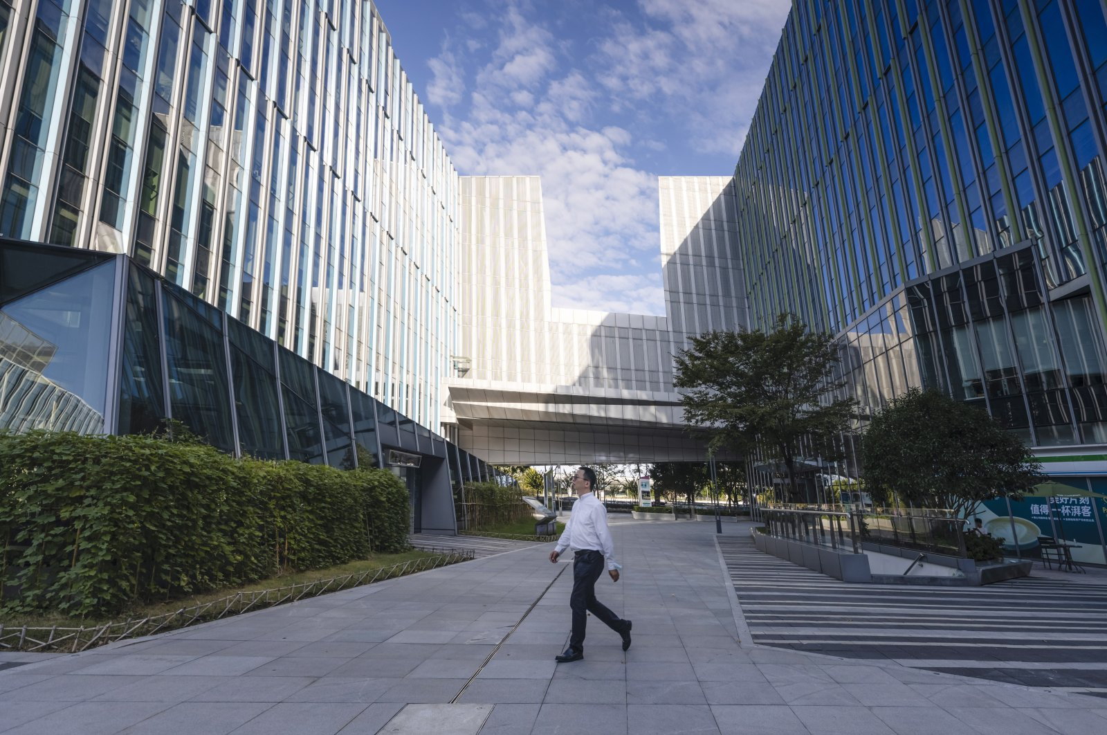 A man walks in front of the Sinic Holdings Shanghai headquarters building in Shanghai, China, Oct. 6, 2021. (EPA Photo)