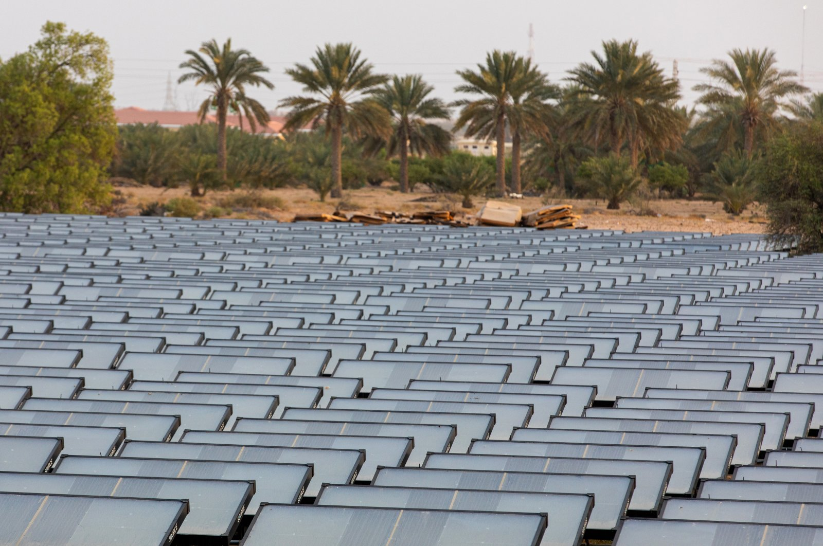 This file photo dated July 8, 2020, shows hydropanels, produced by Zero Mass Water Inc., at the planned site of the IBV drinking water plant in Lehbab, Dubai, United Arab Emirates, using technology to extract moisture from the atmosphere using energy from the sun. (Christopher Pike/Bloomberg via Getty Images)