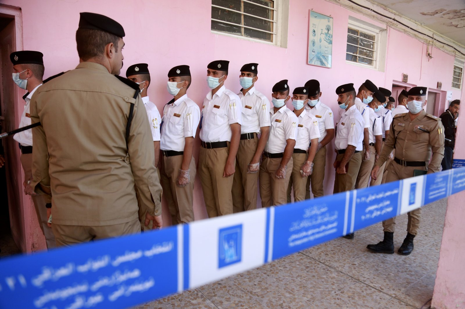 Security forces gather to vote during a special voting ahead of Sunday's parliamentary election in Baghdad, Iraq, Friday, Oct. 8, 2021. (AP Photo)