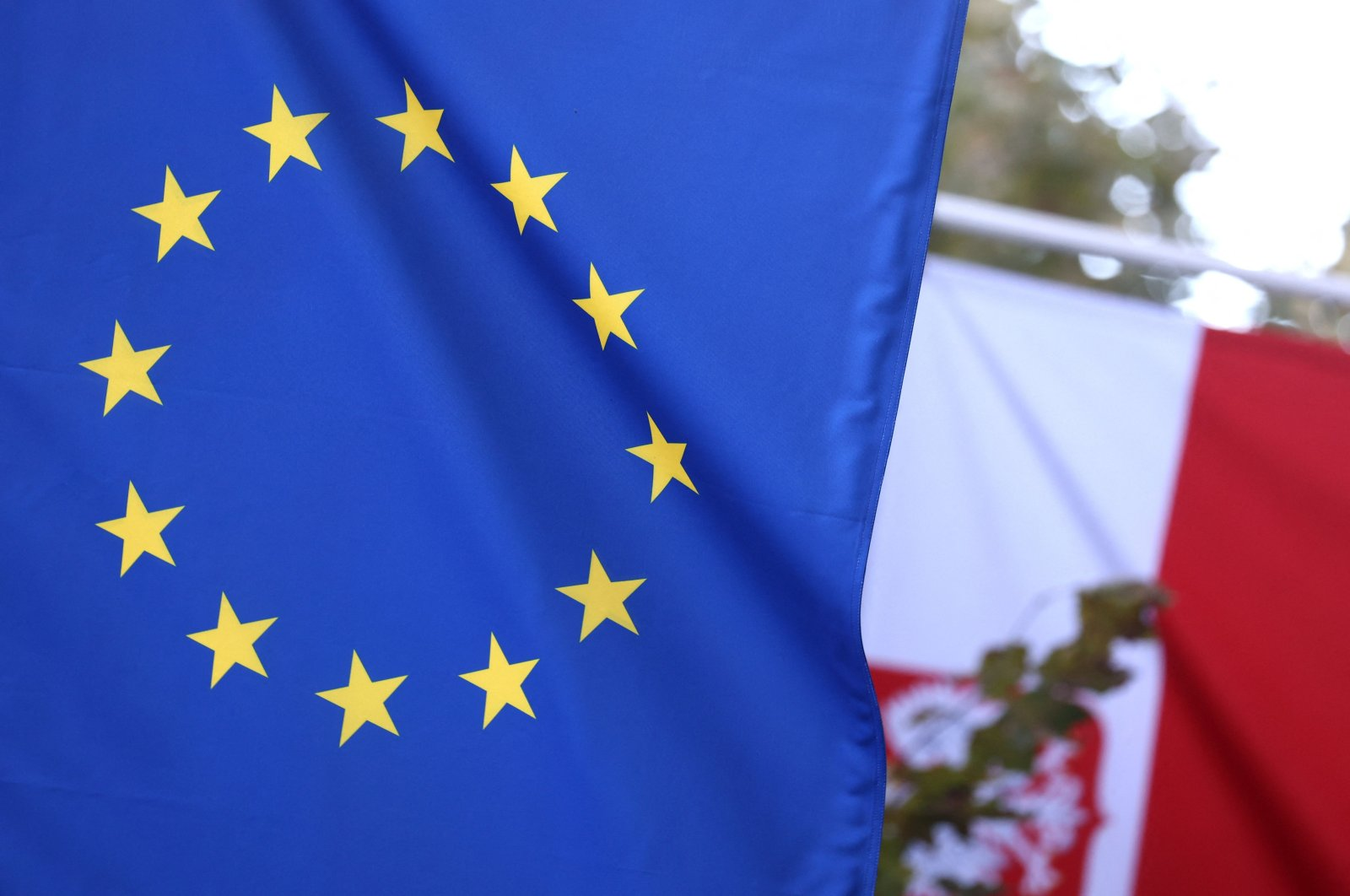 A picture taken on Oct. 8, 2021, shows the Polish flag and European Union flag at the entrance of Poland's permanent representation to the EU in Brussels, Belgium. (AFP Photo)