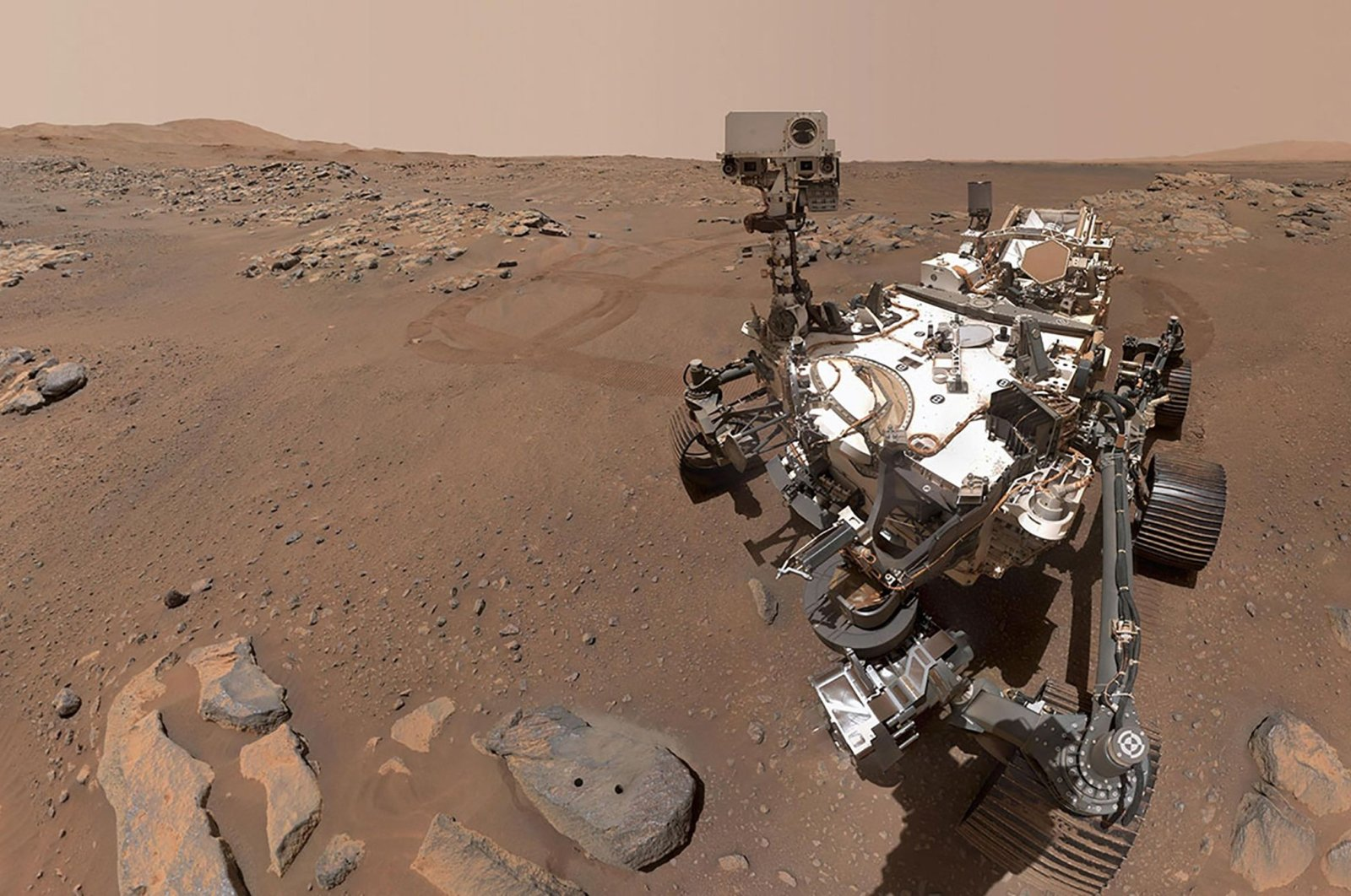 """The Perseverance Mars rover, using its WATSON camera, takes this selfie over a rock nicknamed """"Rochette"""" where two holes can be seen where the rover used its robotic arm to drill rock core samples, Sept. 10, 2021. (NASA via AFP)"""