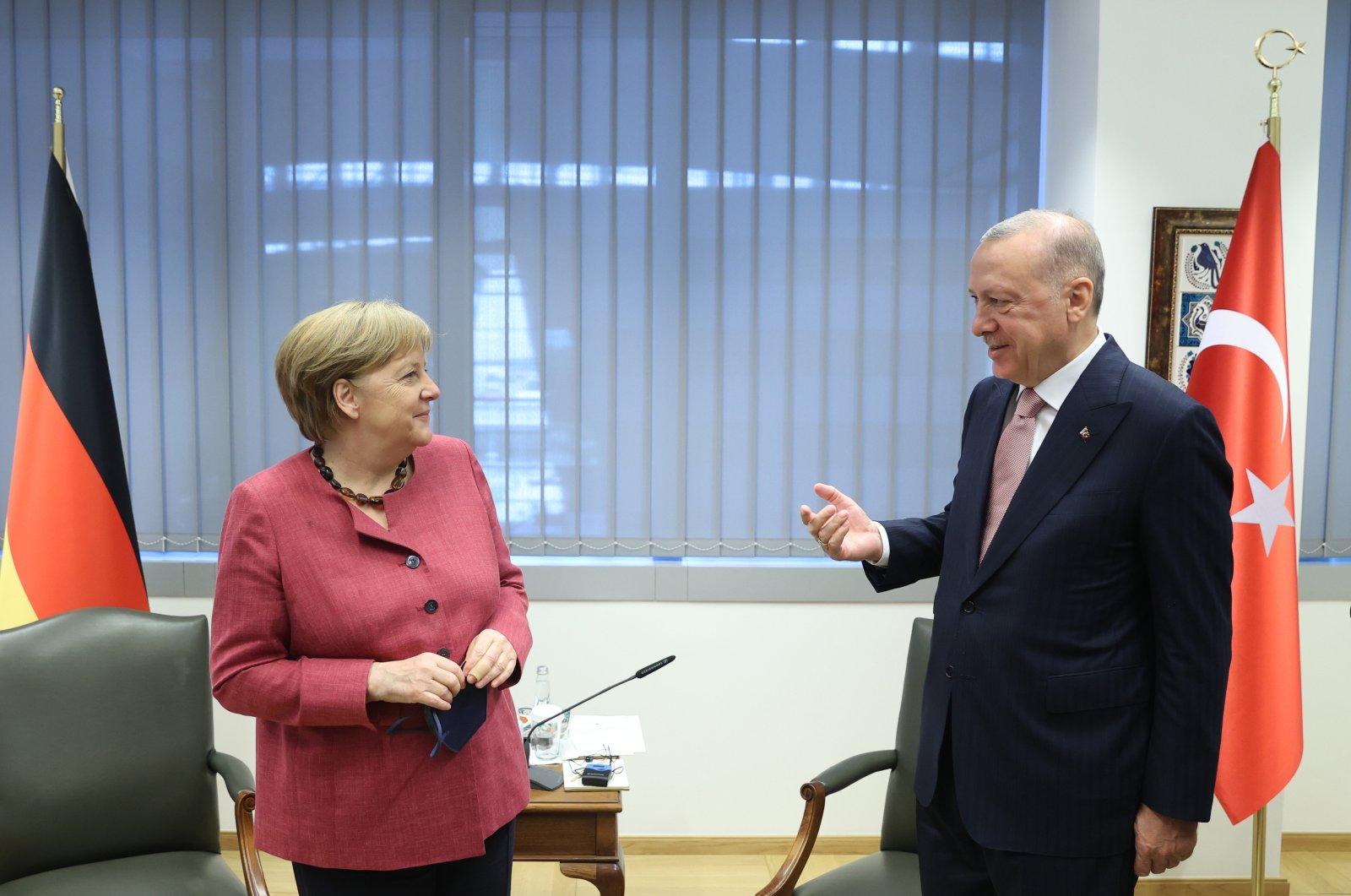 President Recep Tayyip Erdoğan and German Chancellor Angela Merkel gesture during a meeting on the sidelines of NATO meeting in Brussels, June 15, 2021. (AA Photo)