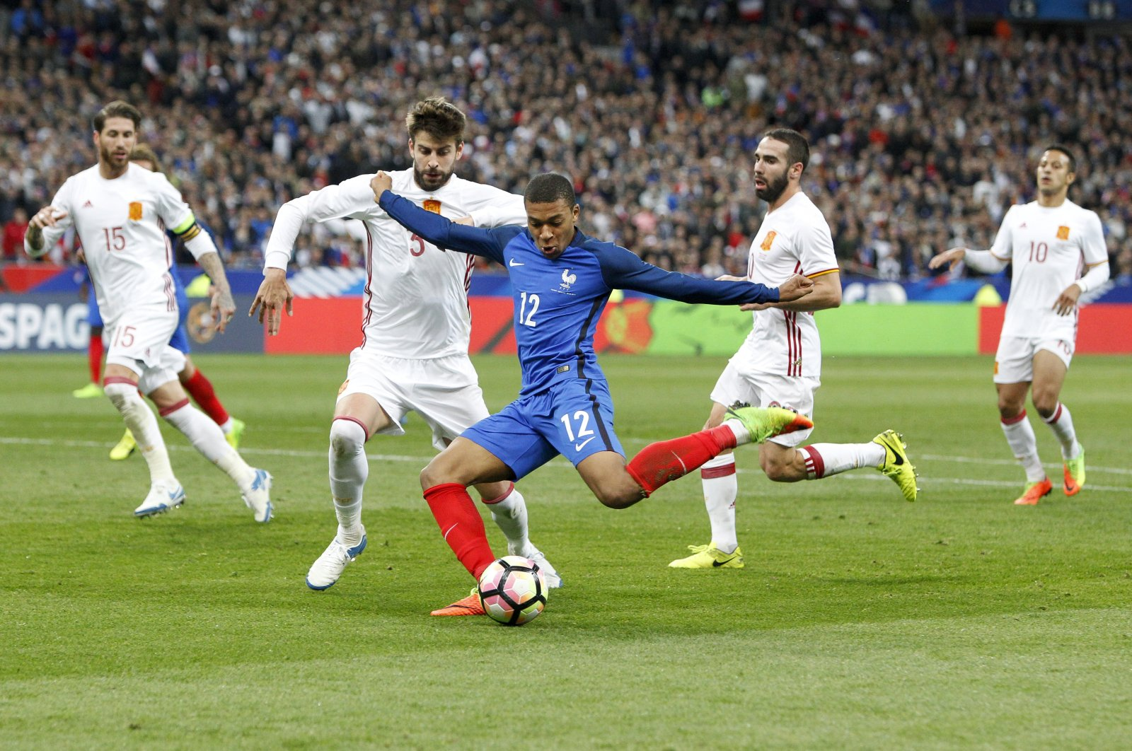 France's Kylian MBappe controls the ball against Spain's Gerard Pique during a friendly match at Stade de France, in Saint-Denis, France, March 28, 2017. (Getty Images)