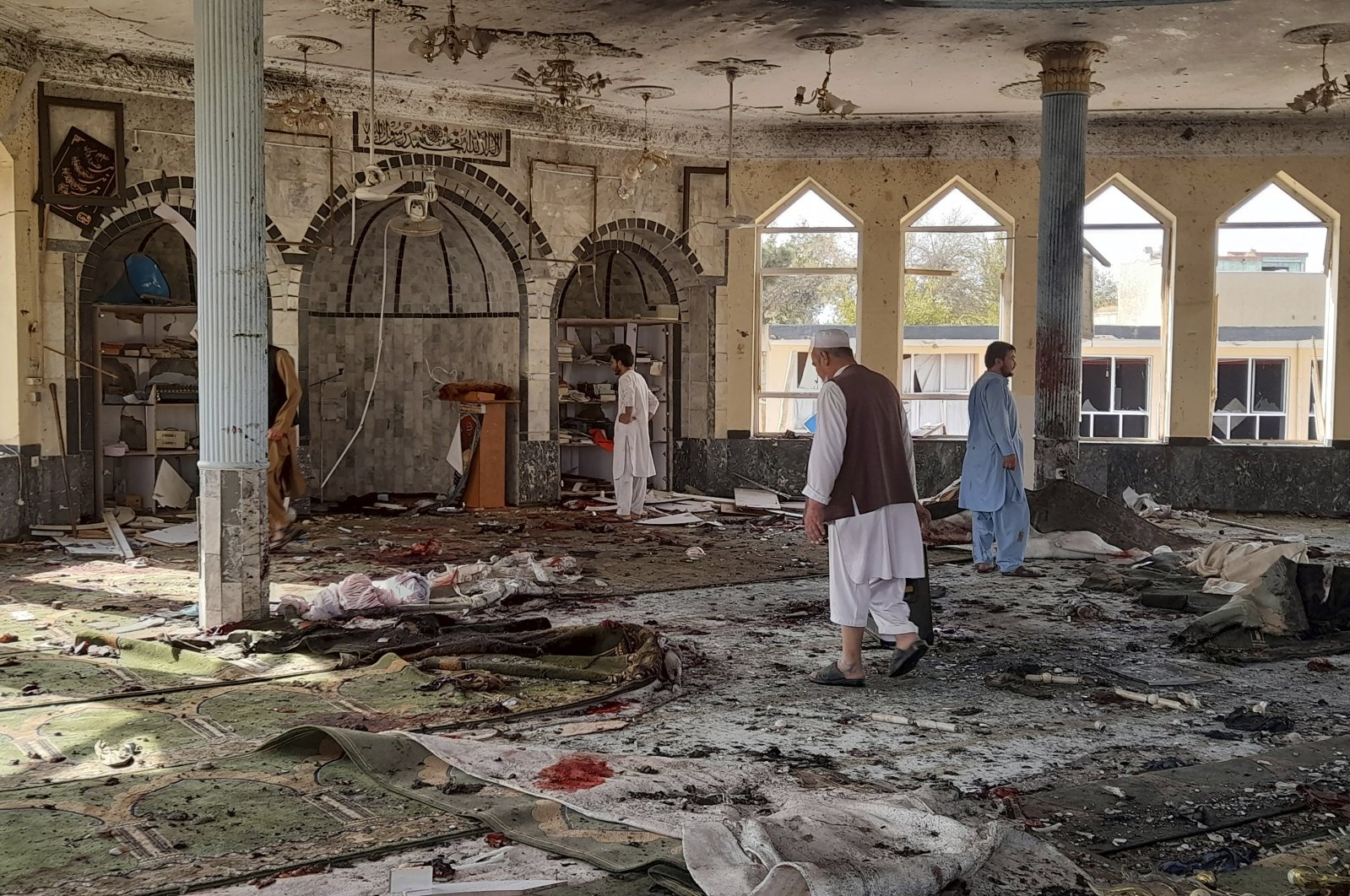 People inspect the inside of a mosque following a bombing in Kunduz province northern Afghanistan, Friday, Oct. 8, 2021. (AP Photo)