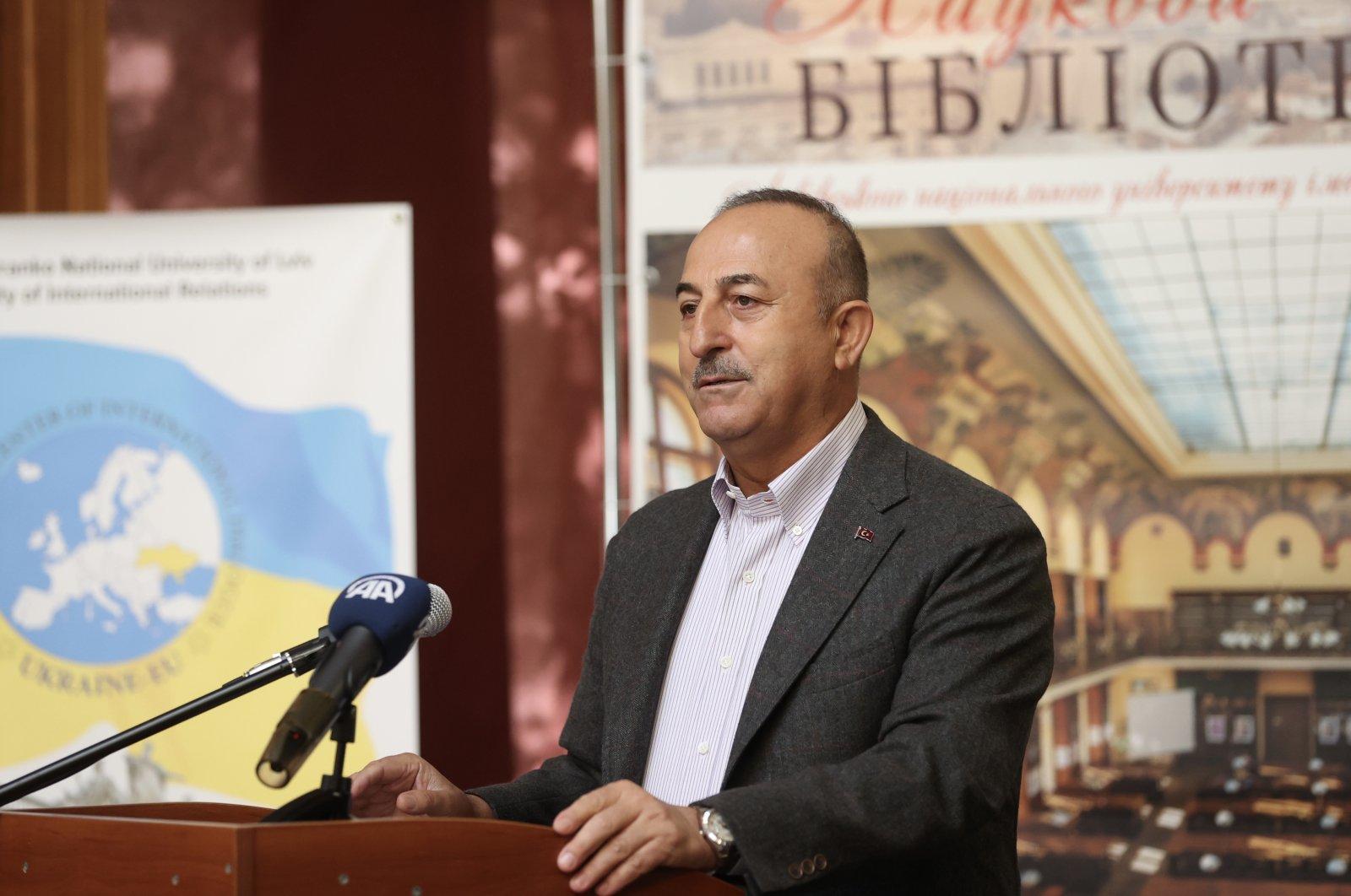 Foreign Minister Mevlüt Çavuşoğlu speaks at a panel hosted by Ivan Franko National University of Lviv in western Ukraine, Oct.8, 2021. (AA Photo)