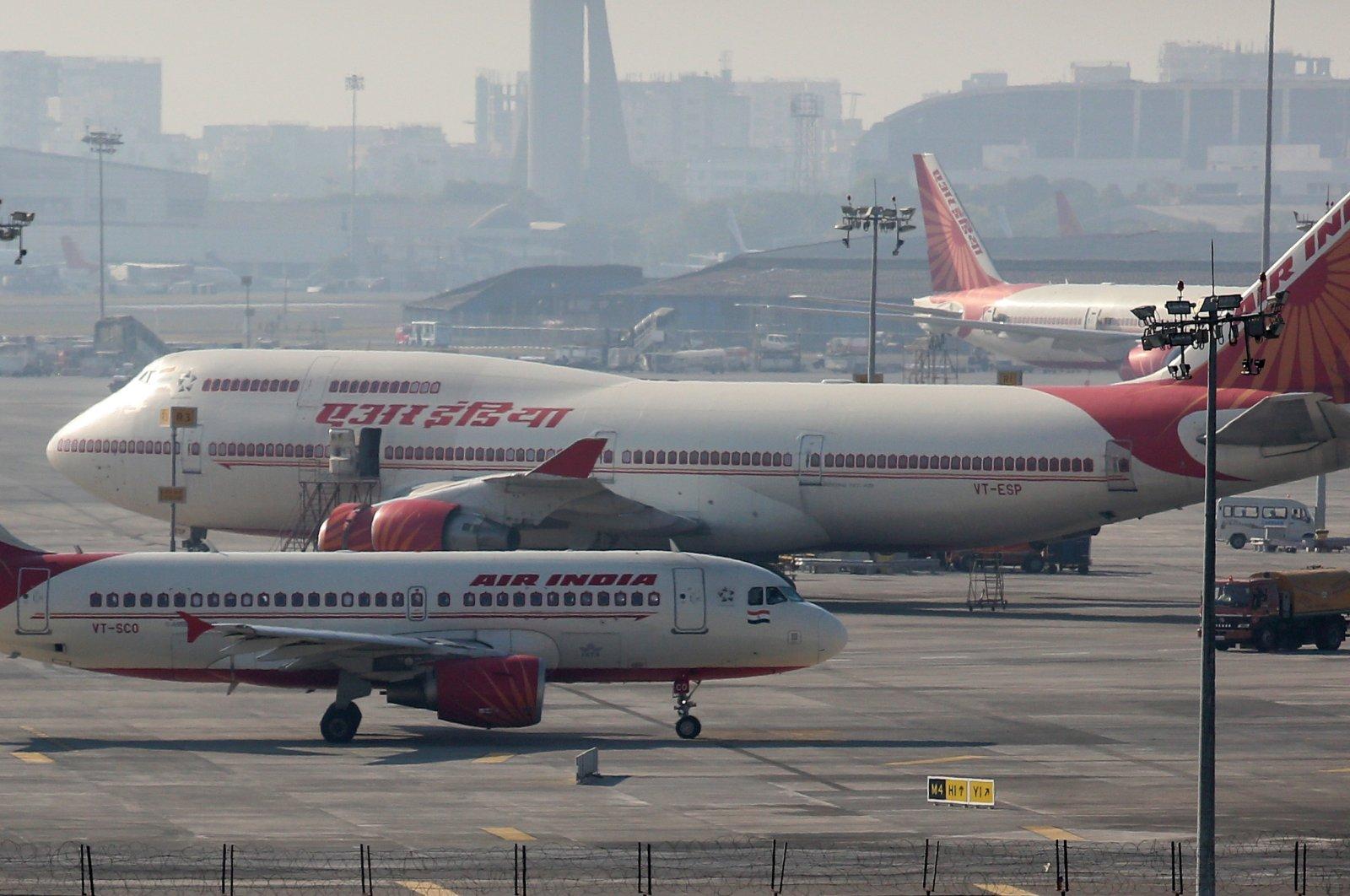 Air India passenger planes are seen at the Chhatrapati Shivaji International Airport in Mumbai, India, Dec. 17, 2015. (EPA Photo)