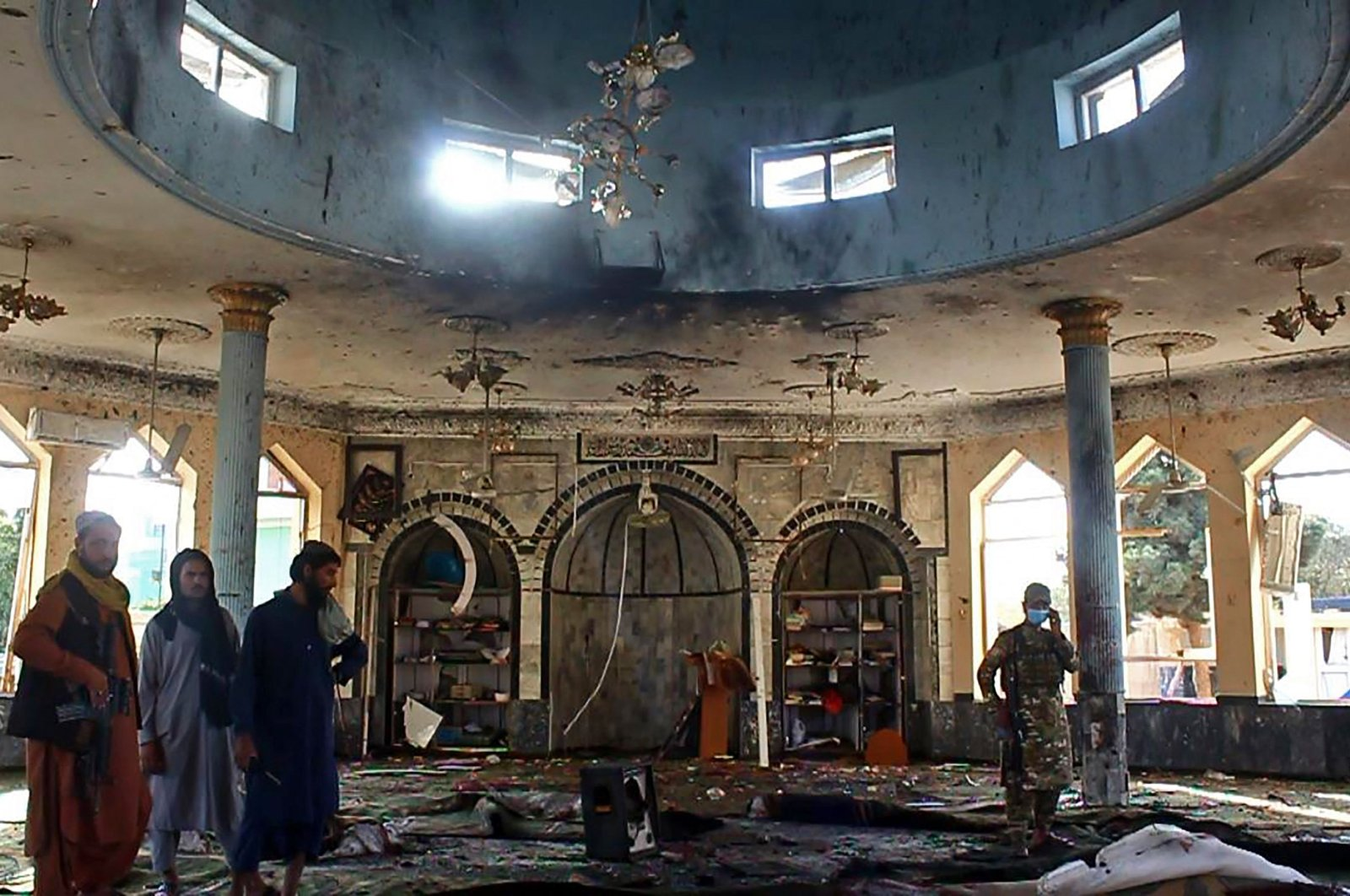 Taliban fighters investigate inside a Shiite mosque after a suicide bomb attack in Kunduz, Oct. 8, 2021. (AFP Photo)