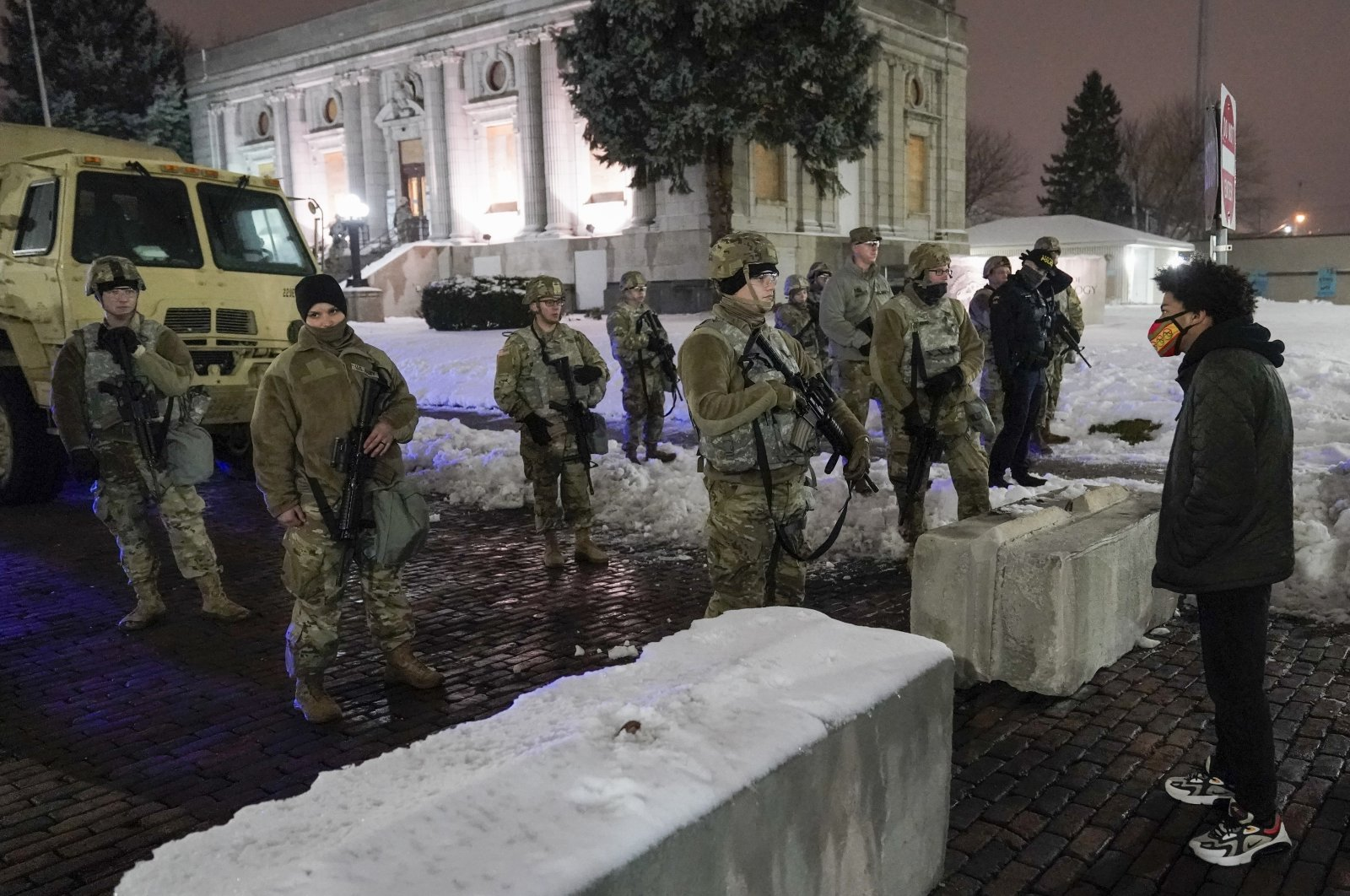 A protester confronts National Guard members outside a museum, in Kenosha, Wis., U.S, Jan. 5, 2021. (AP File Photo)