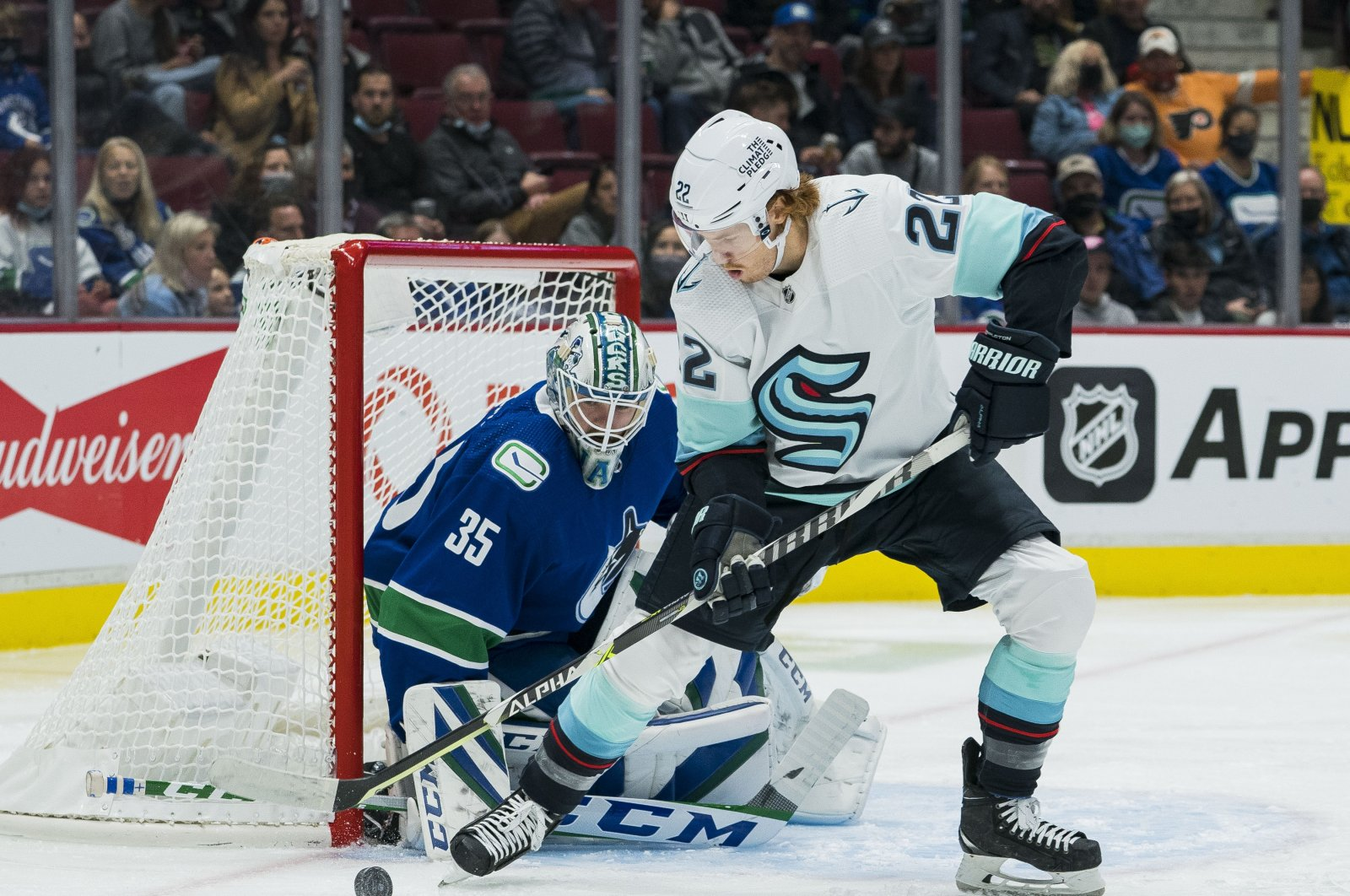 Vancouver Canucks goalie Thatcher Demko (35) makes a save against Seattle Kraken forward Mason Appleton (22) in the second period at Rogers Arena, Vancouver, Canada, Oct. 5, 2021. (Bob Frid-USA TODAY Sports via Reuters)