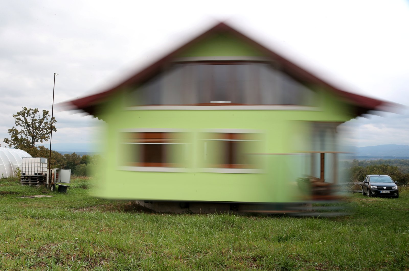 Vojin Kusic house is seen while rotating by electric motors and wheels from a military transporter in Srbac, Bosnia and Herzegovina, Oct. 9, 2021. (Reuters Photo)
