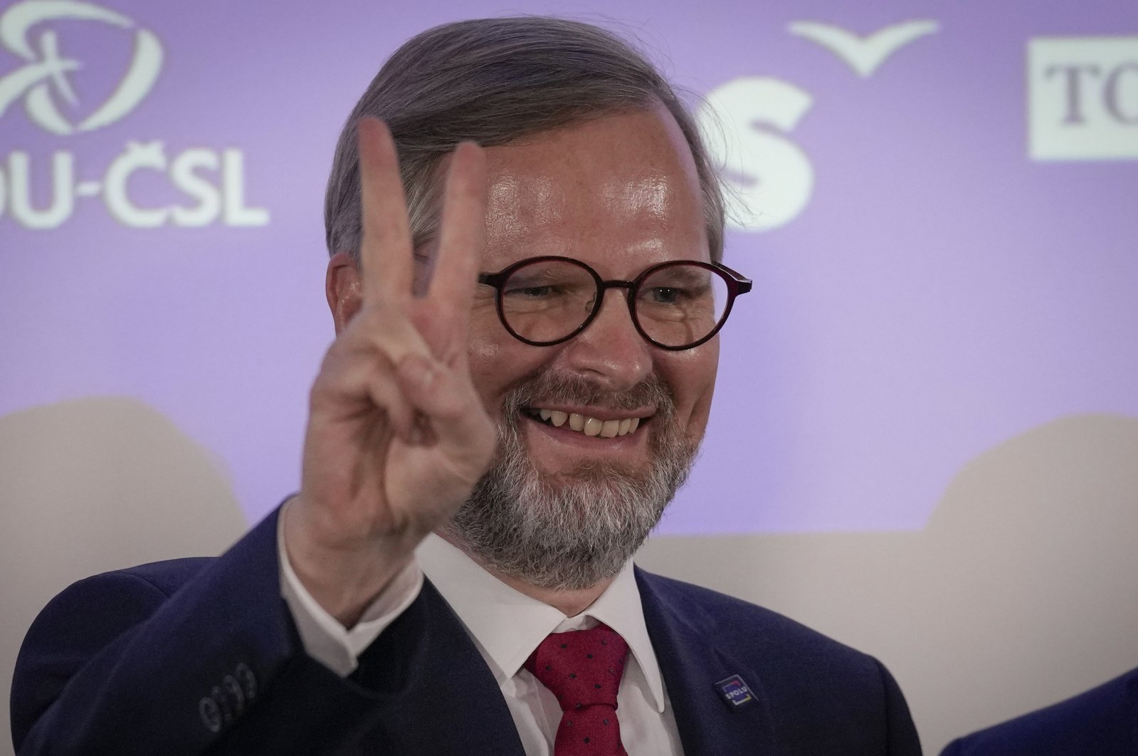 Leader of center-right Spolu (Together) coalition Petr Fiala flashes the V sign as he reacts to election results at the party's election headquarters, Prague, Czech Republic, Saturday, Oct. 9, 2021. (AP Photo)